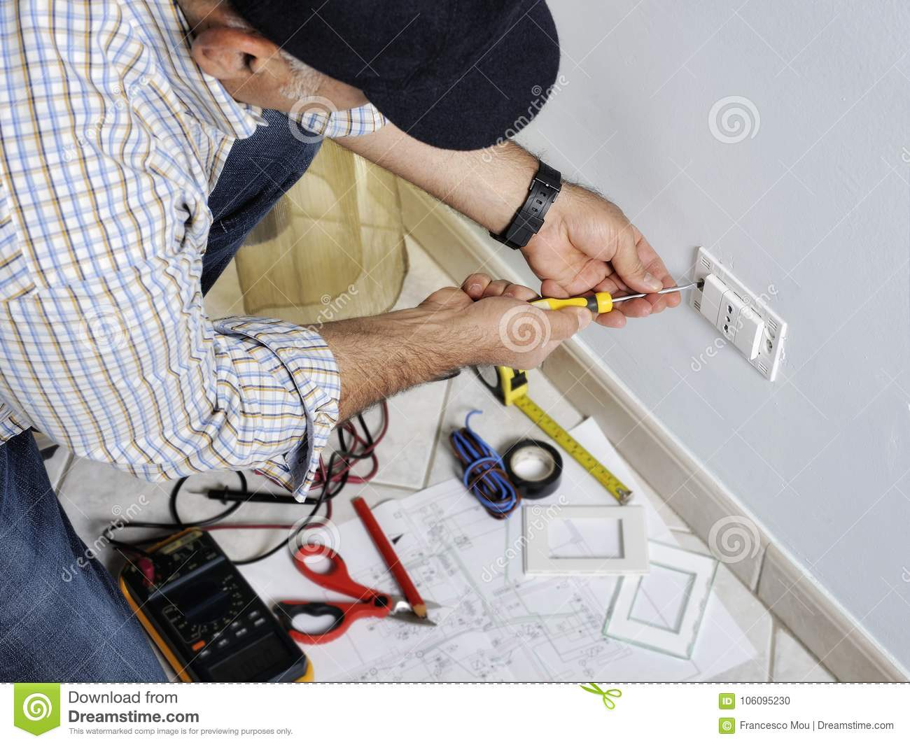 Electrician Working In A Residential Electrical System Stock Photo ...