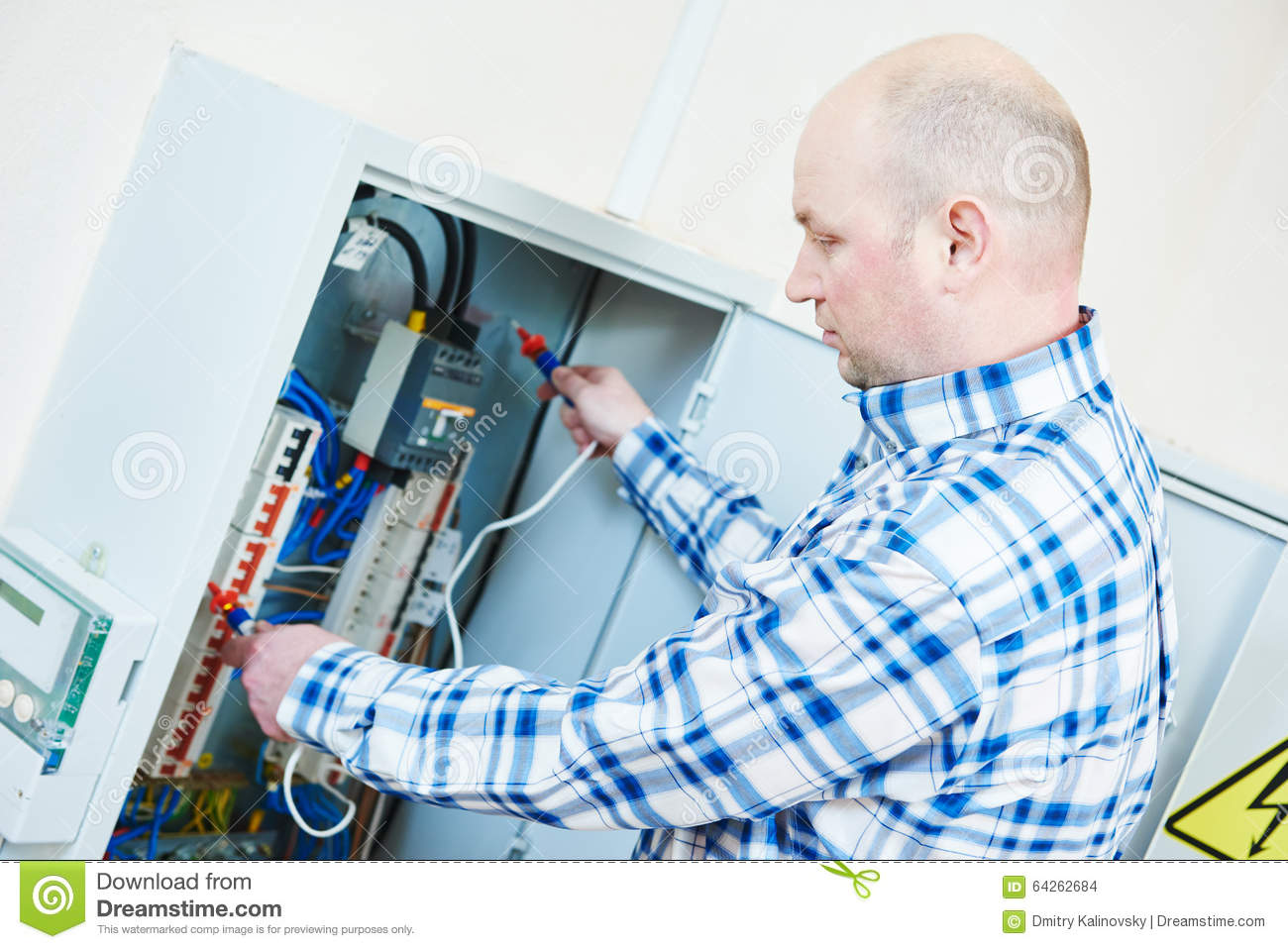 electrician works with electric meter tester in fuse box stock photoelectrician works with electric meter tester in fuse box