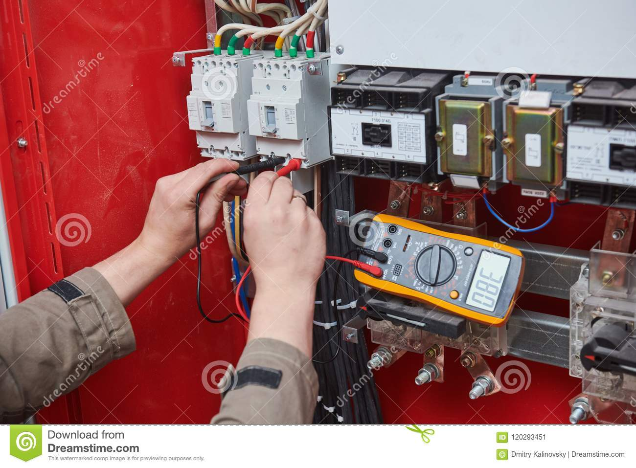 Electrician Measurements With Multimeter Tester Stock Image Dc Fuse Box Works Male Technician Examining Fusebox Digital Ac