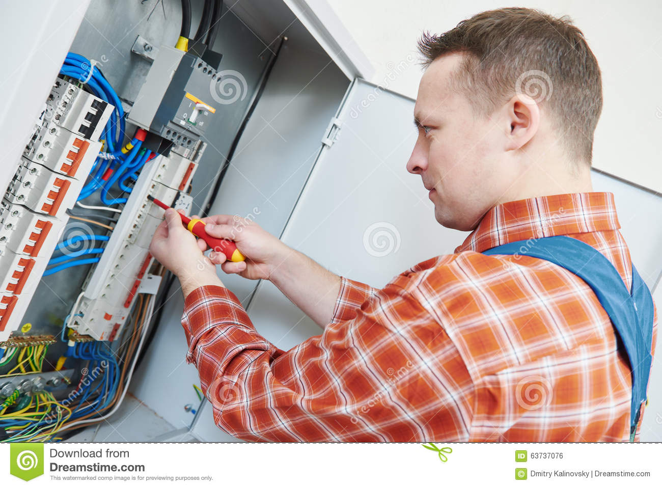 Electrician Works With Screwdriver In Fuse Box Stock Photo - Image
