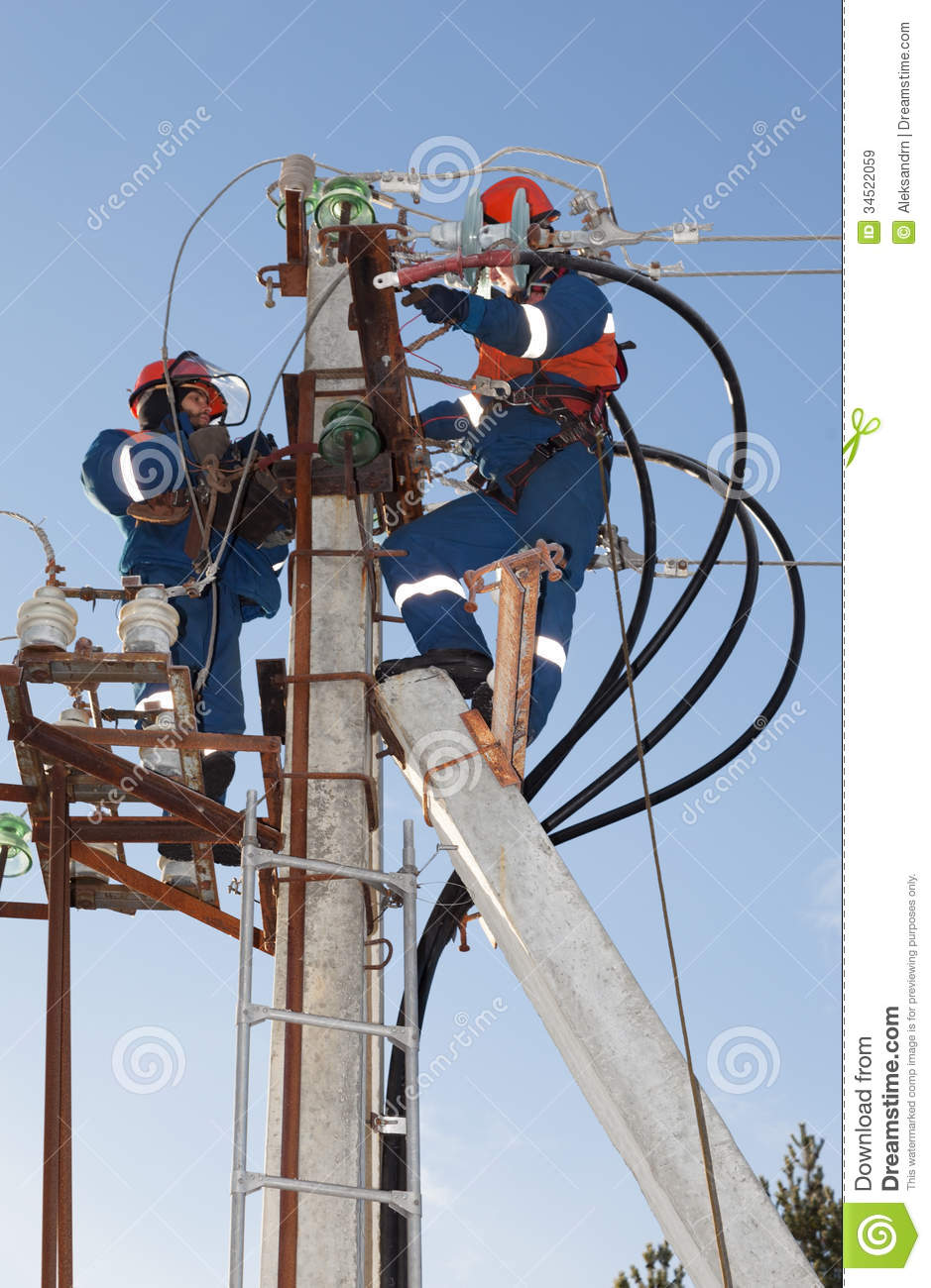 Electricians Troubleshoot On Power Lines Stock Image