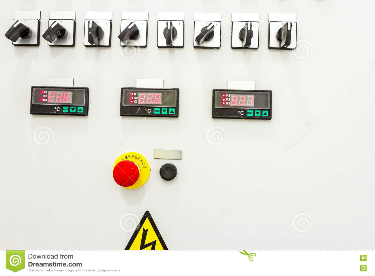 electrical control panel containing has a digital temperature gauge with  warning sticker and an emergency shutdown (panic) button