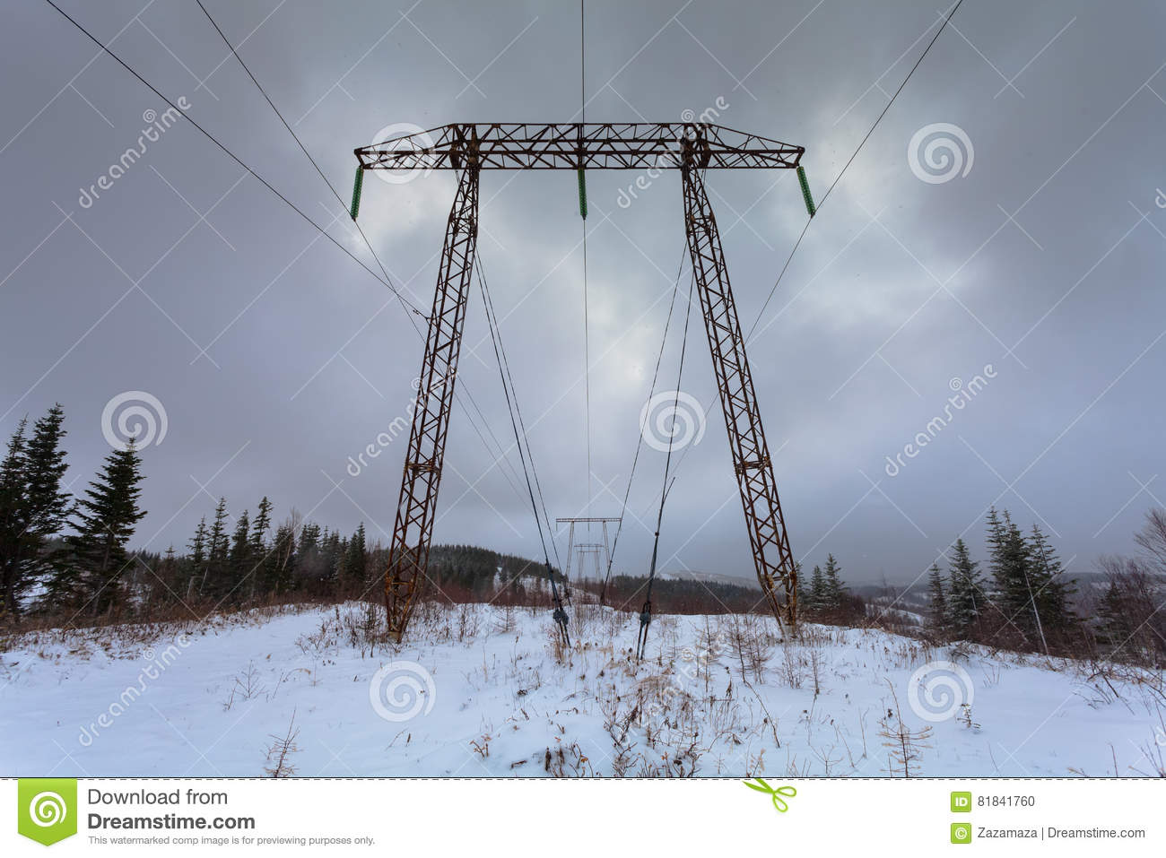 Electricity transmission power lines on winter background High voltage tower. Metal electricity transmission pylon.