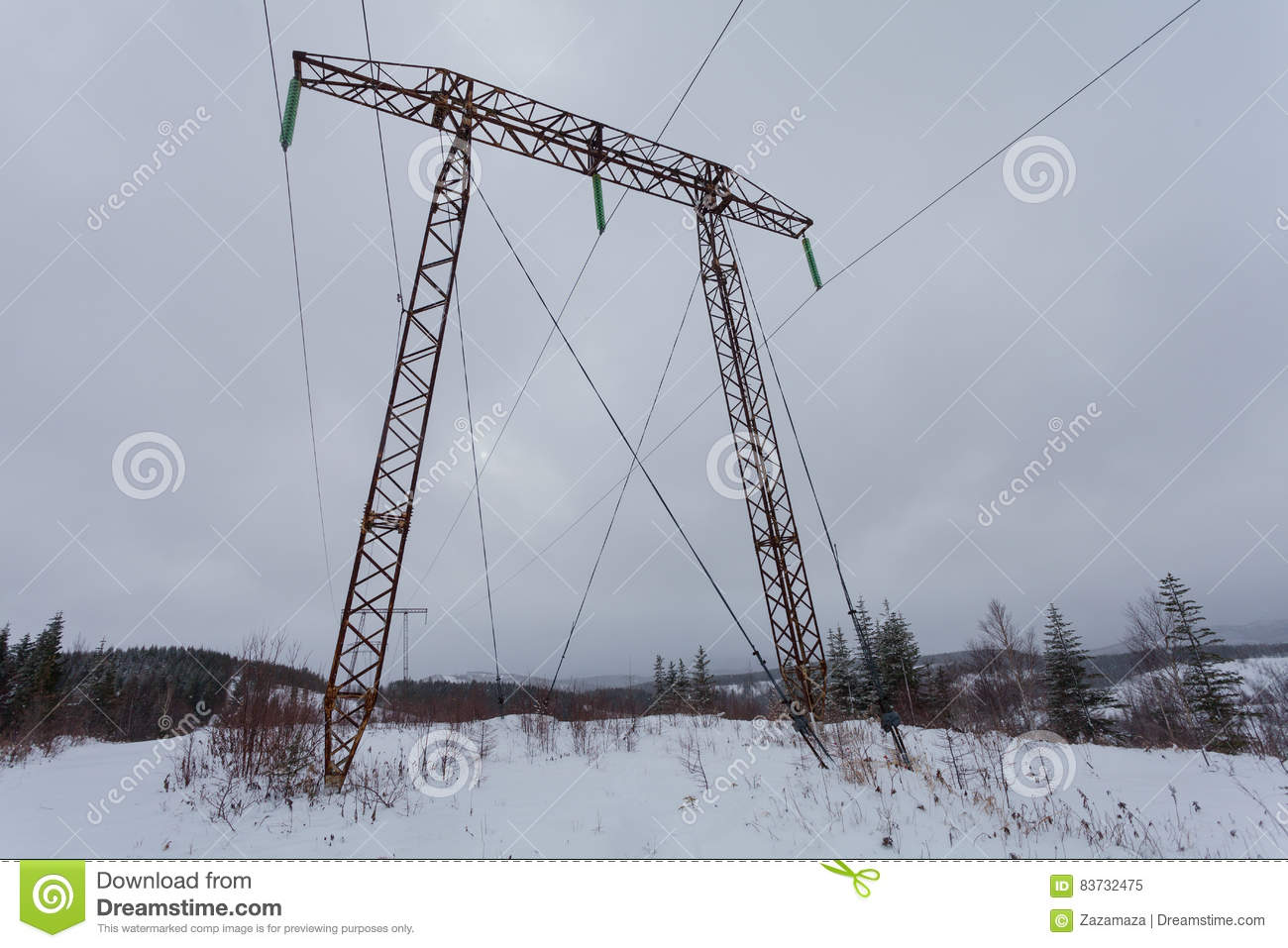 Electricity transmission power lines on winter background High voltage tower.