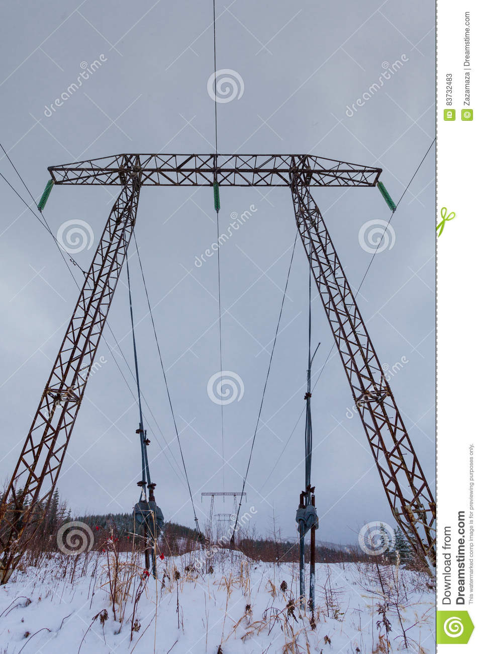 Electricity transmission power lines on winter background High voltage tower