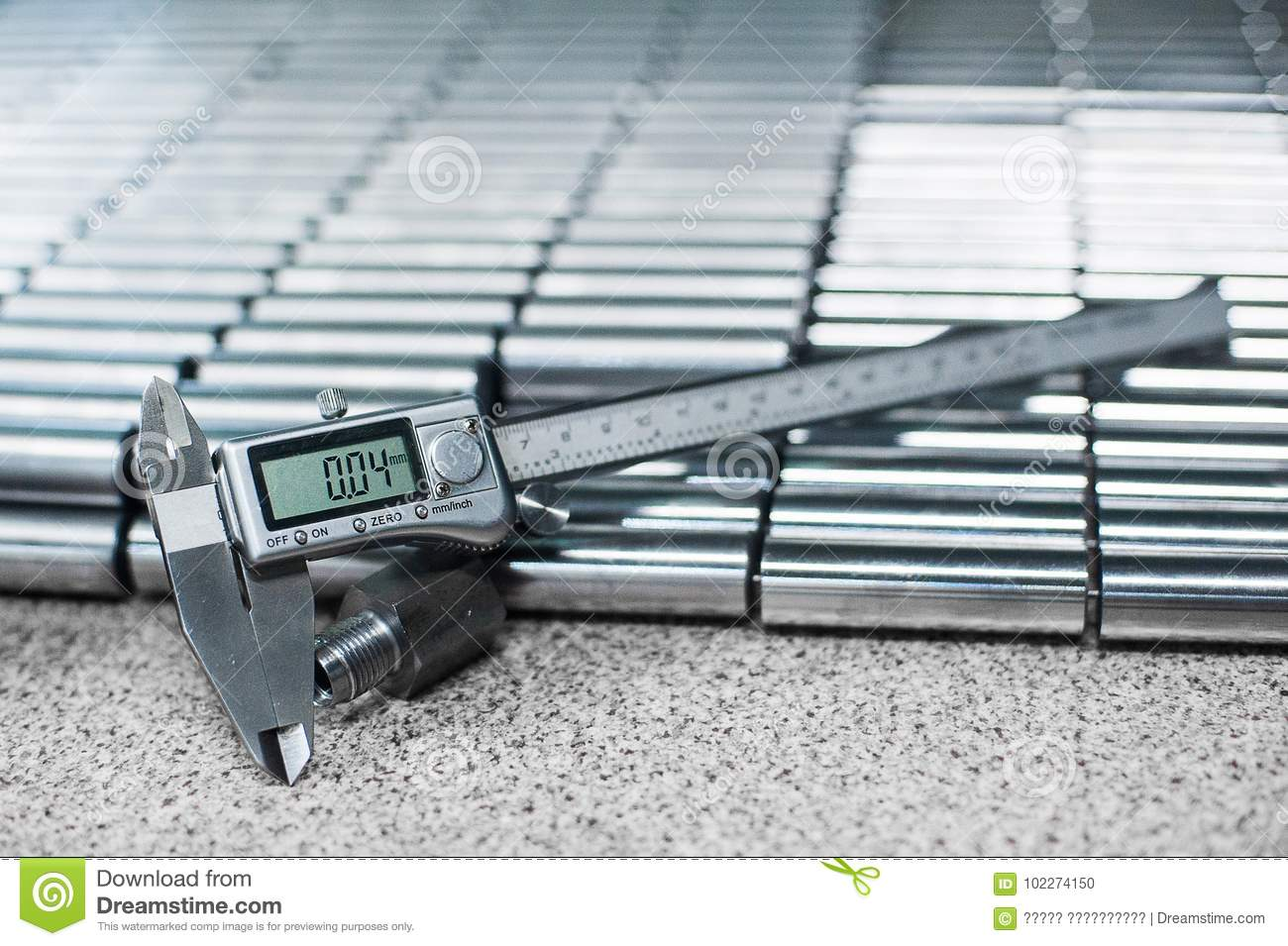 Electronic caliper in front of bearing rollers. Close up, depth of field, selective focus