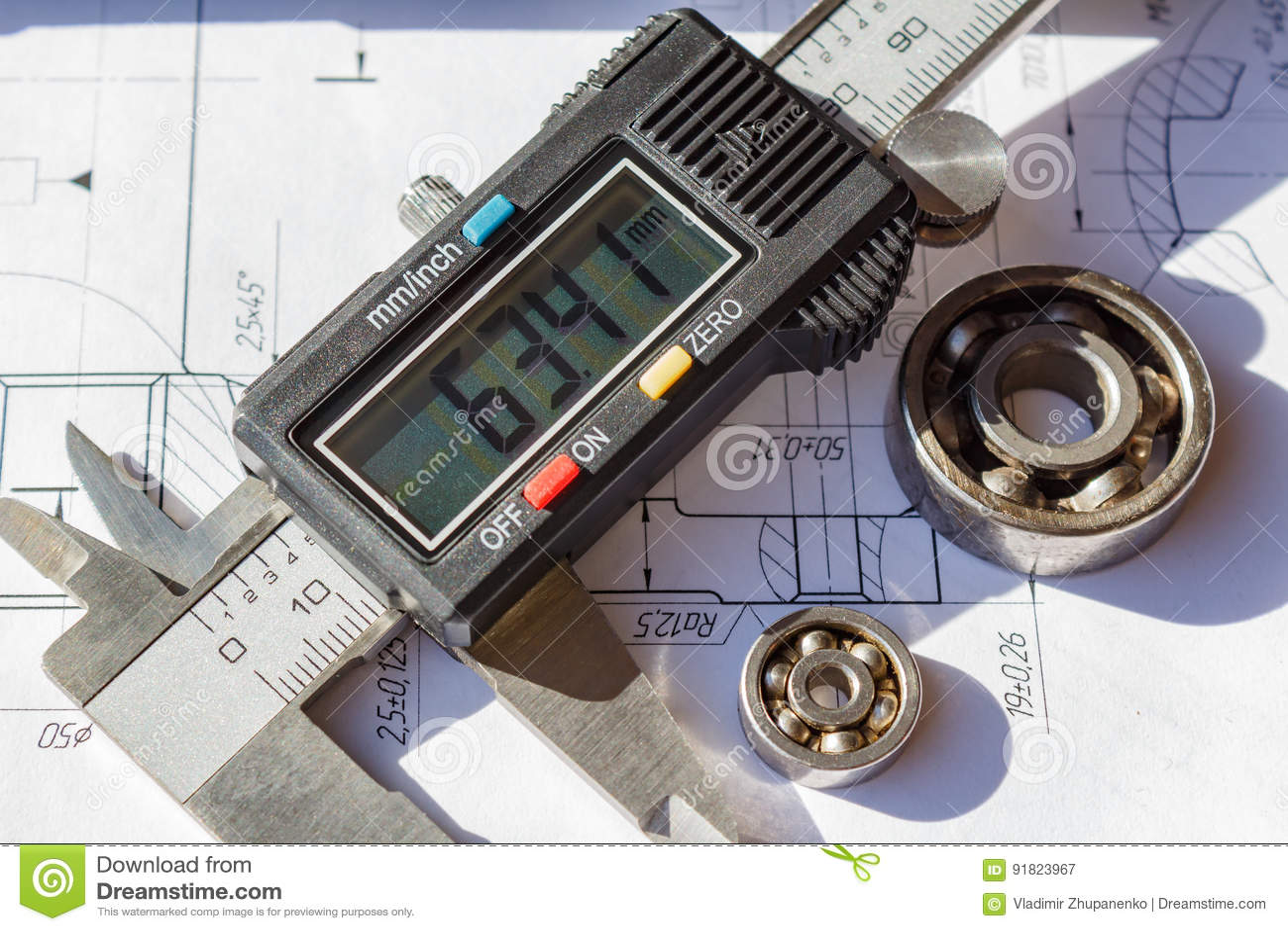 Electronic caliper and used ball bearings closeup
