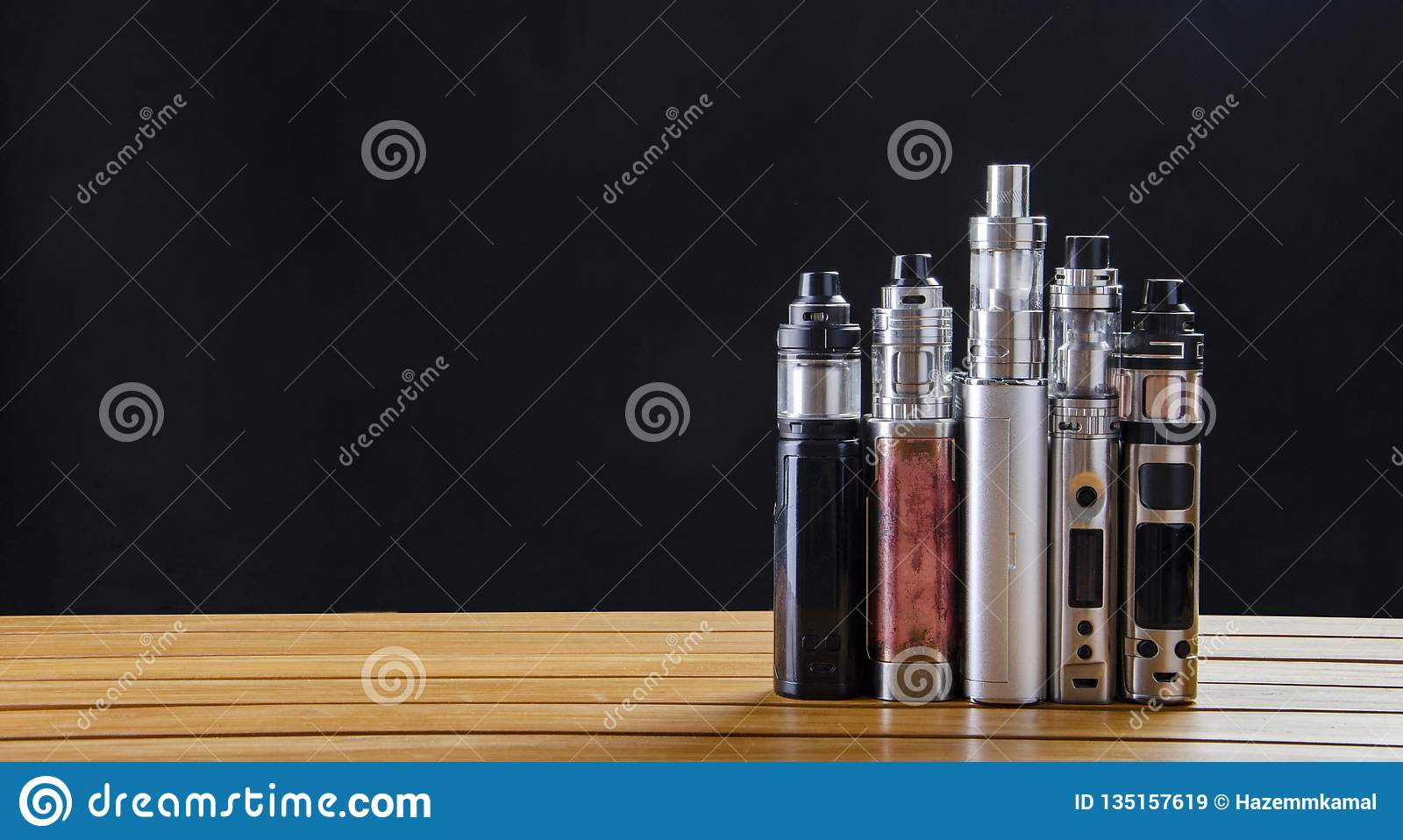 Electronic Cigarette Mods For Ecig Over A Wooden ...