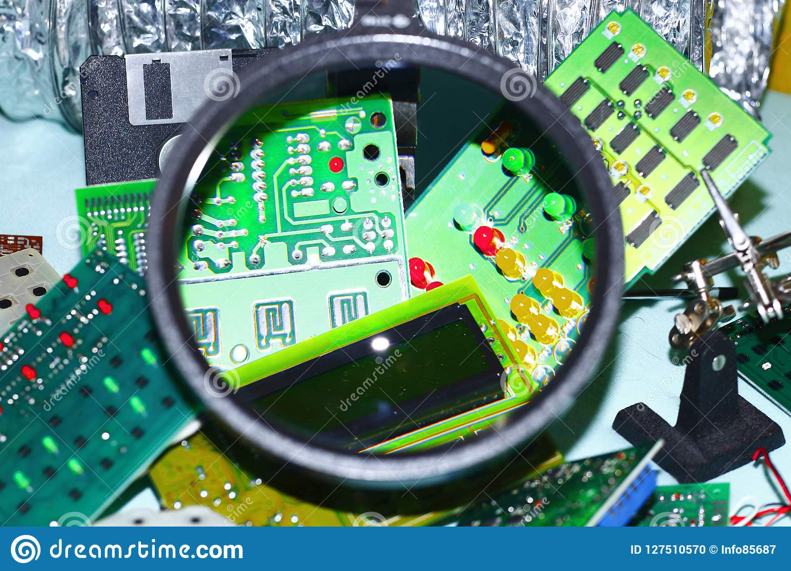 Electronic Circuit Boards On A Blue Background Plus Magnifying Games Cards Shot Through Round Glass Well Drawn Elements Of The Board Leds And Other
