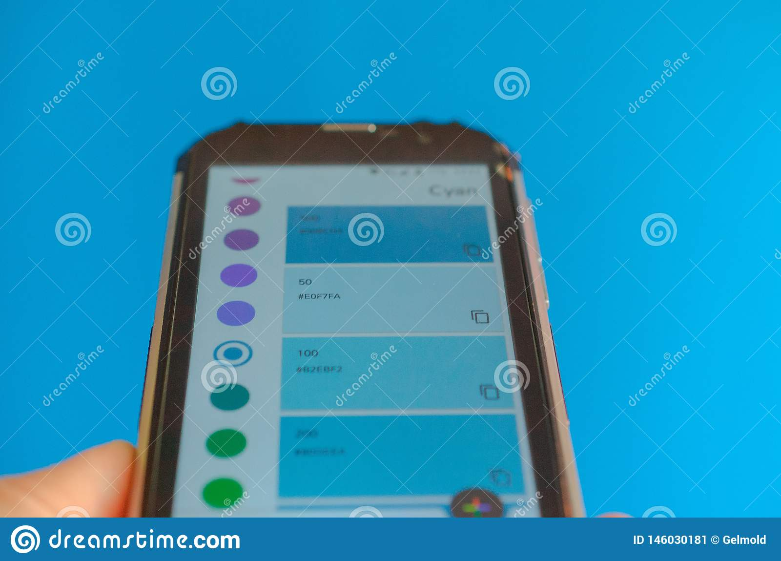 Electronic color palettes between smartphone and blue background.