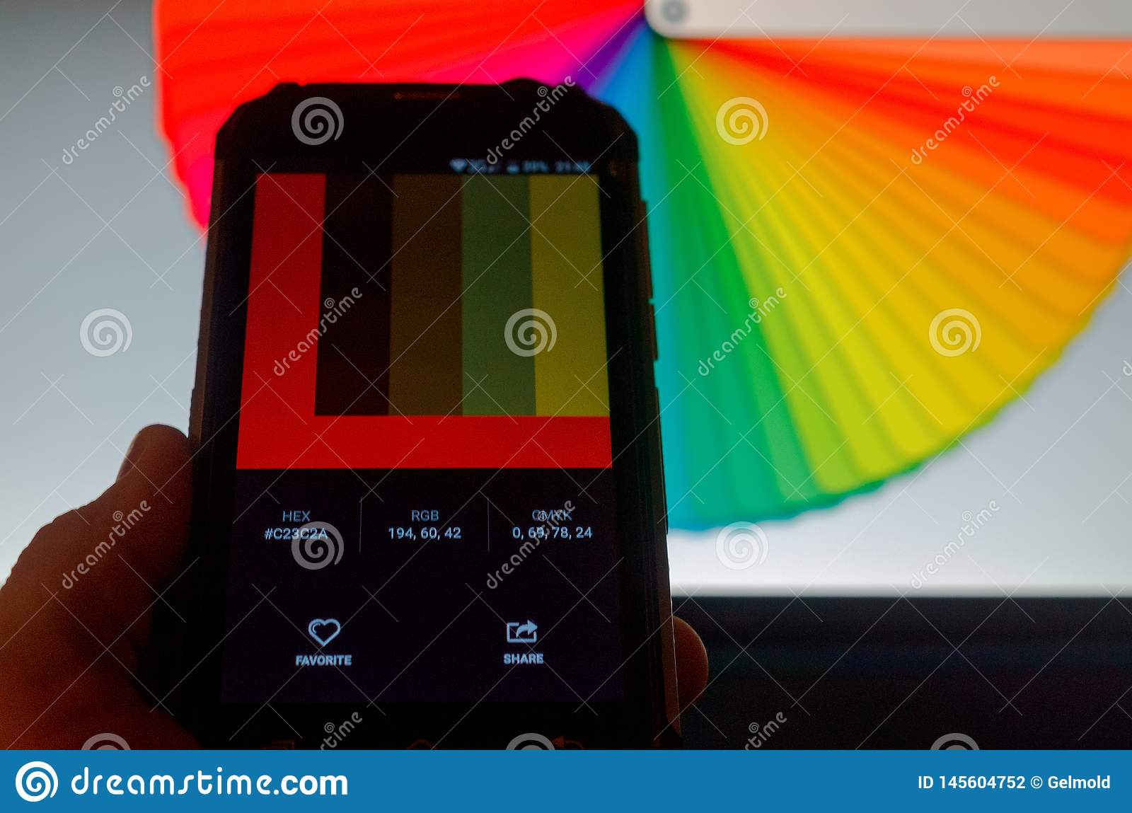 Electronic color palettes between a smartphone and a laptop.