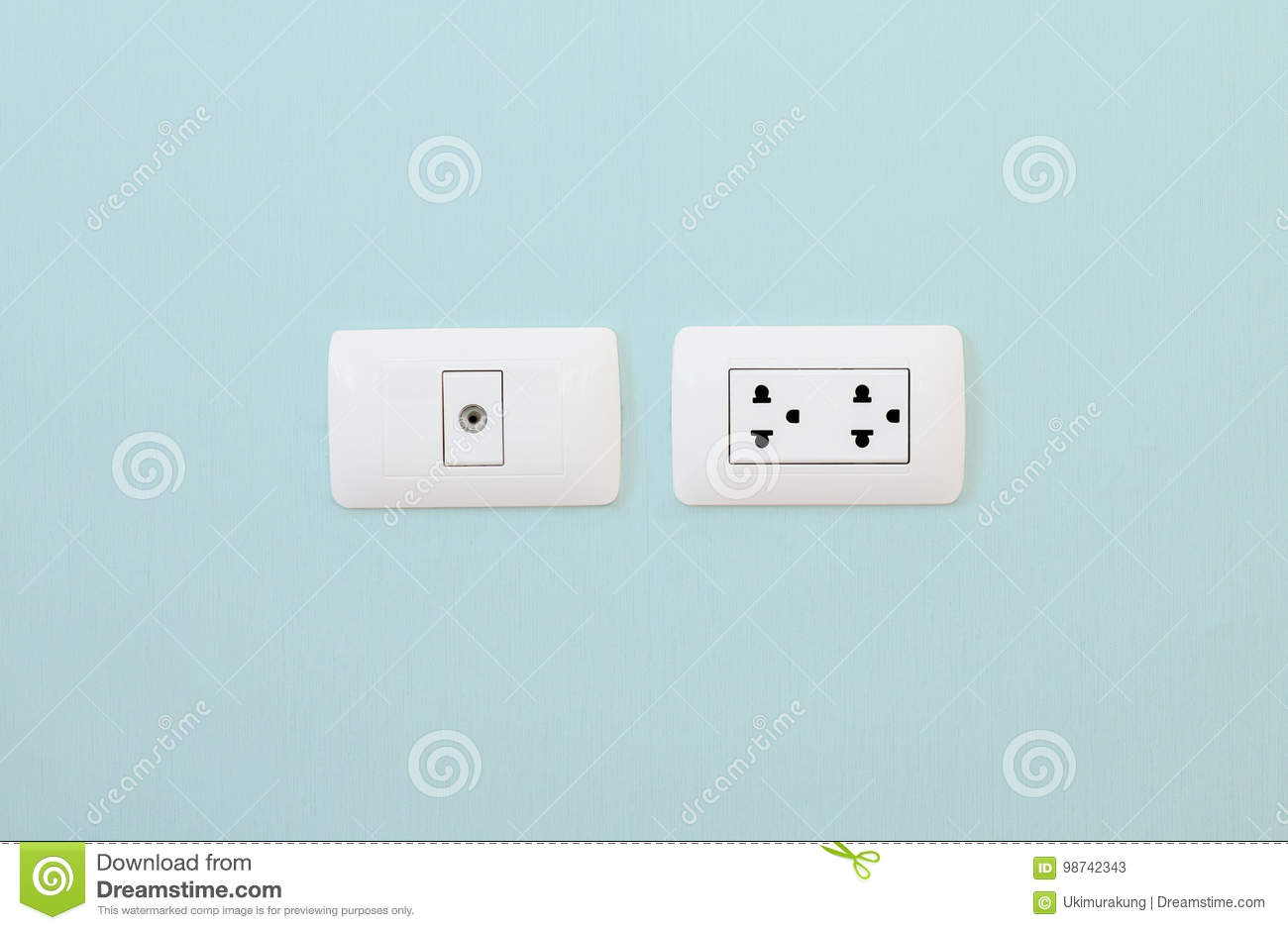 Electronic Plug And Television Cable Outlet On The Blue Wall Stock ...