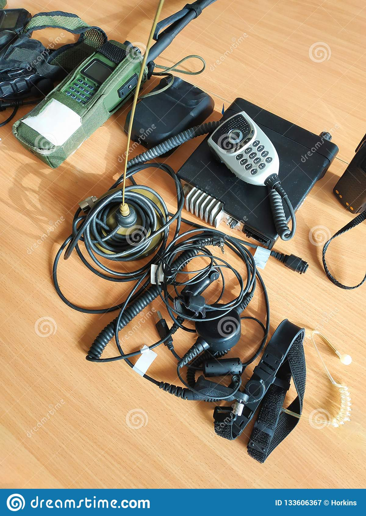 electronic radio set devices on the tables wires military headphones
