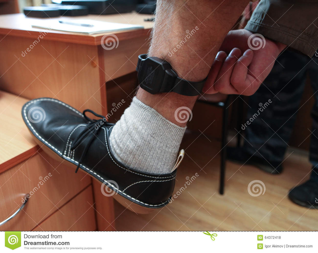 photo electronic monitoring with ankle stock being aka parolee bracelet fitted