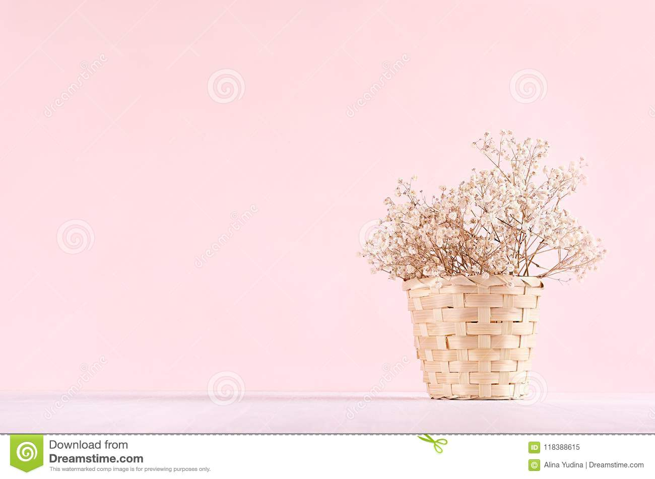 Elegance home eco decor - white dried flowers bouquet in bucket on white table and fashion pink background.
