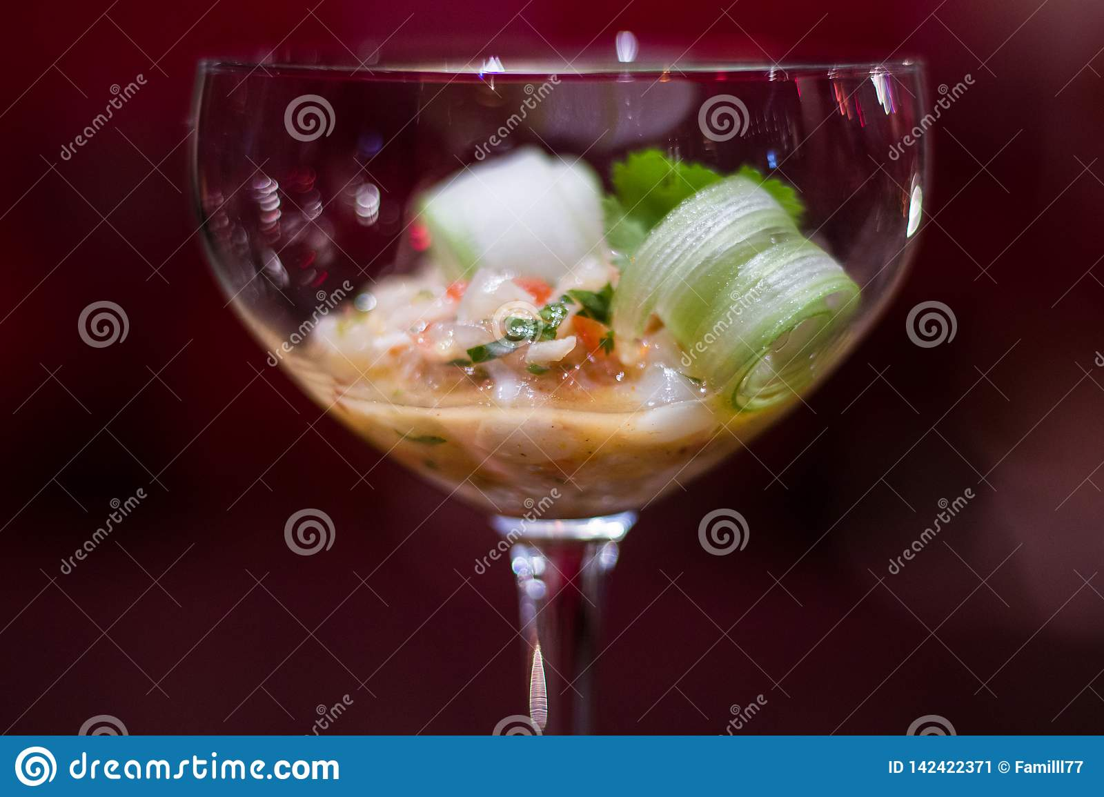 An elegant appetizzer in a cocktail glass
