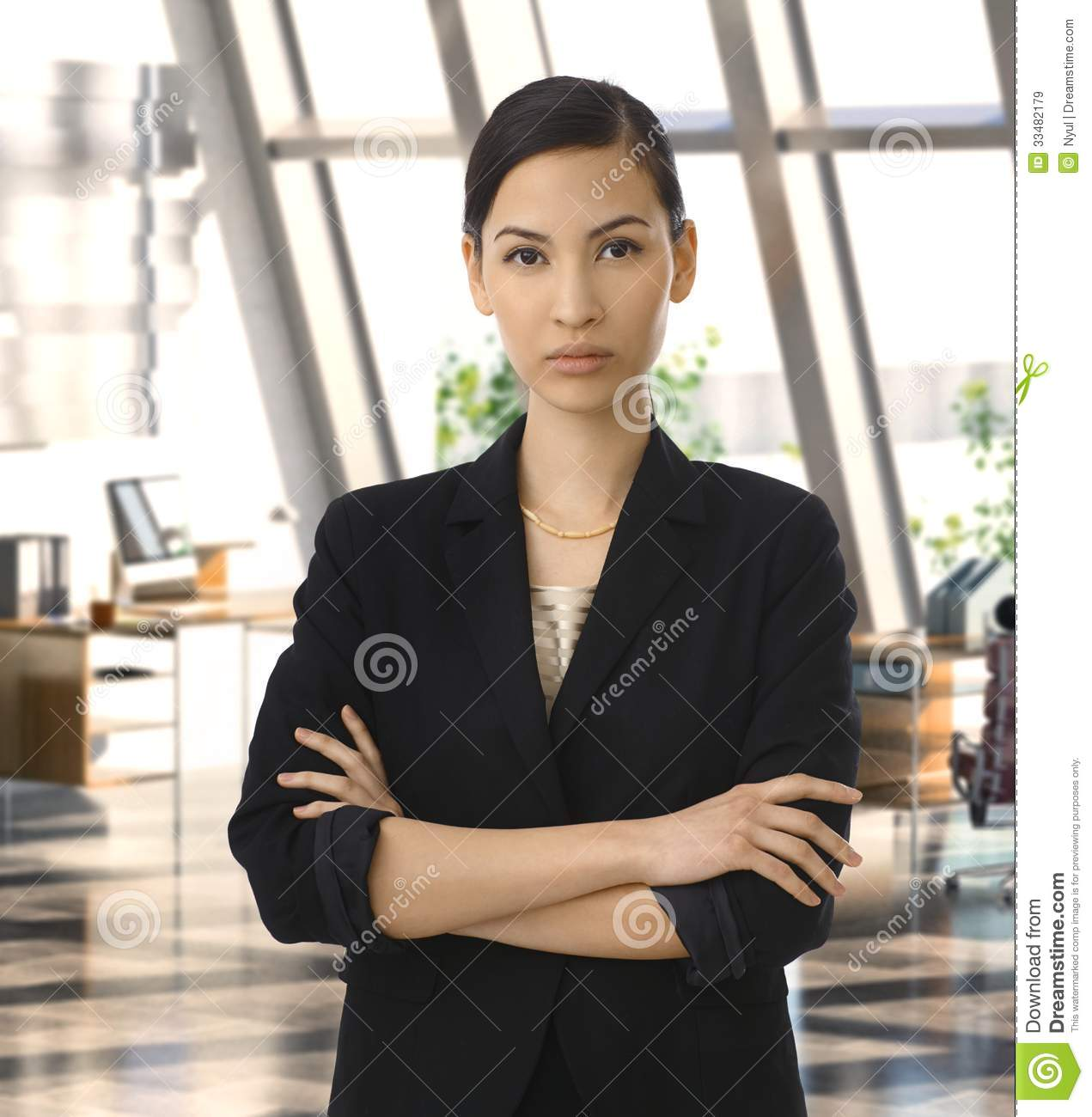 Elegant Asian Elegant Asian Businesswoman In Corporate Office Royalty Free Stock