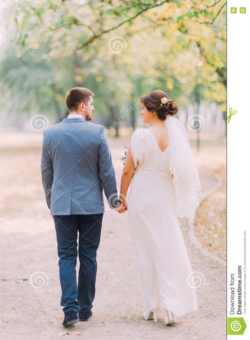 Elegant Bride And Groom Posing Together Outdoors Stock ...