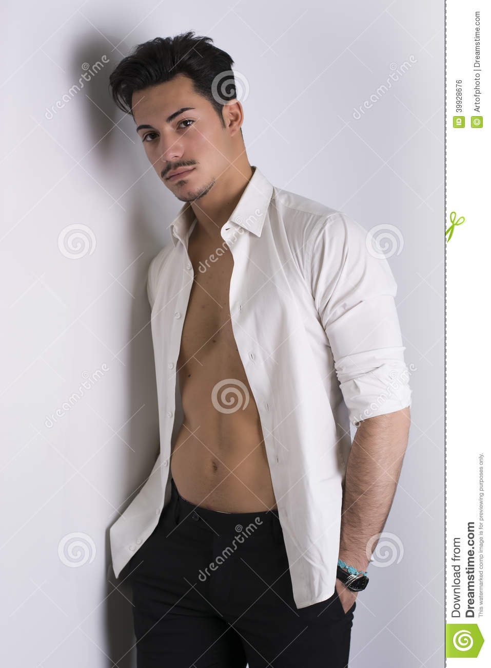 Elegant Attractive Young Man With White Shirt Open On Naked Torso ...