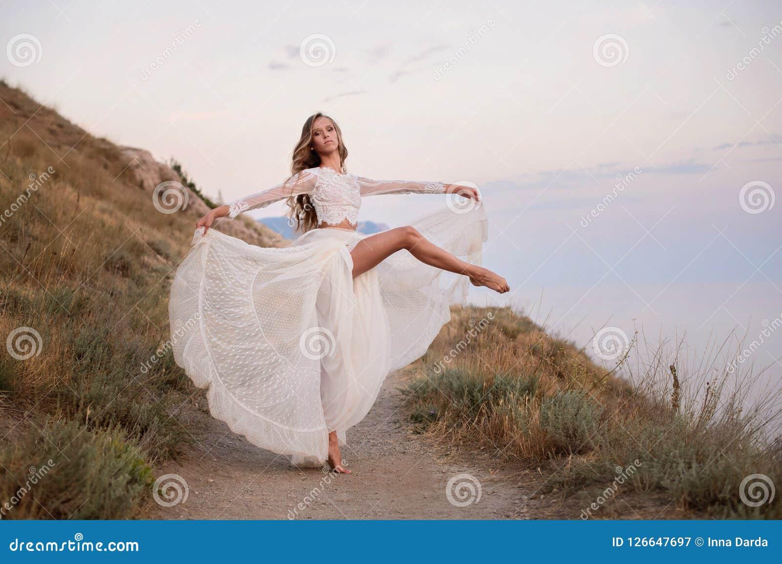 Elegant ballet dancer young girl dancing ballet outdoor