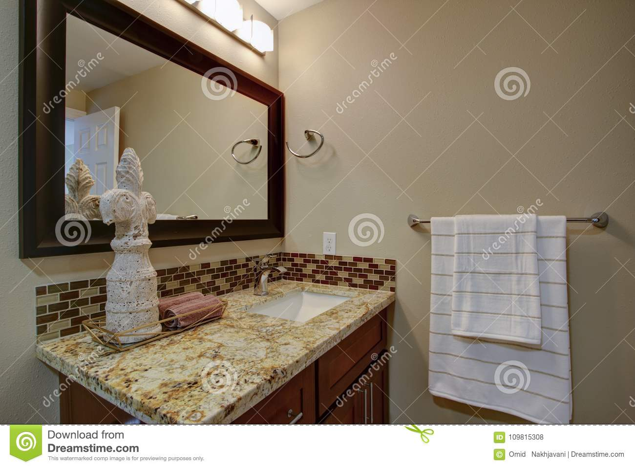 - Elegant Bathroom With A Mahogany Stained Vanity Stock Photo