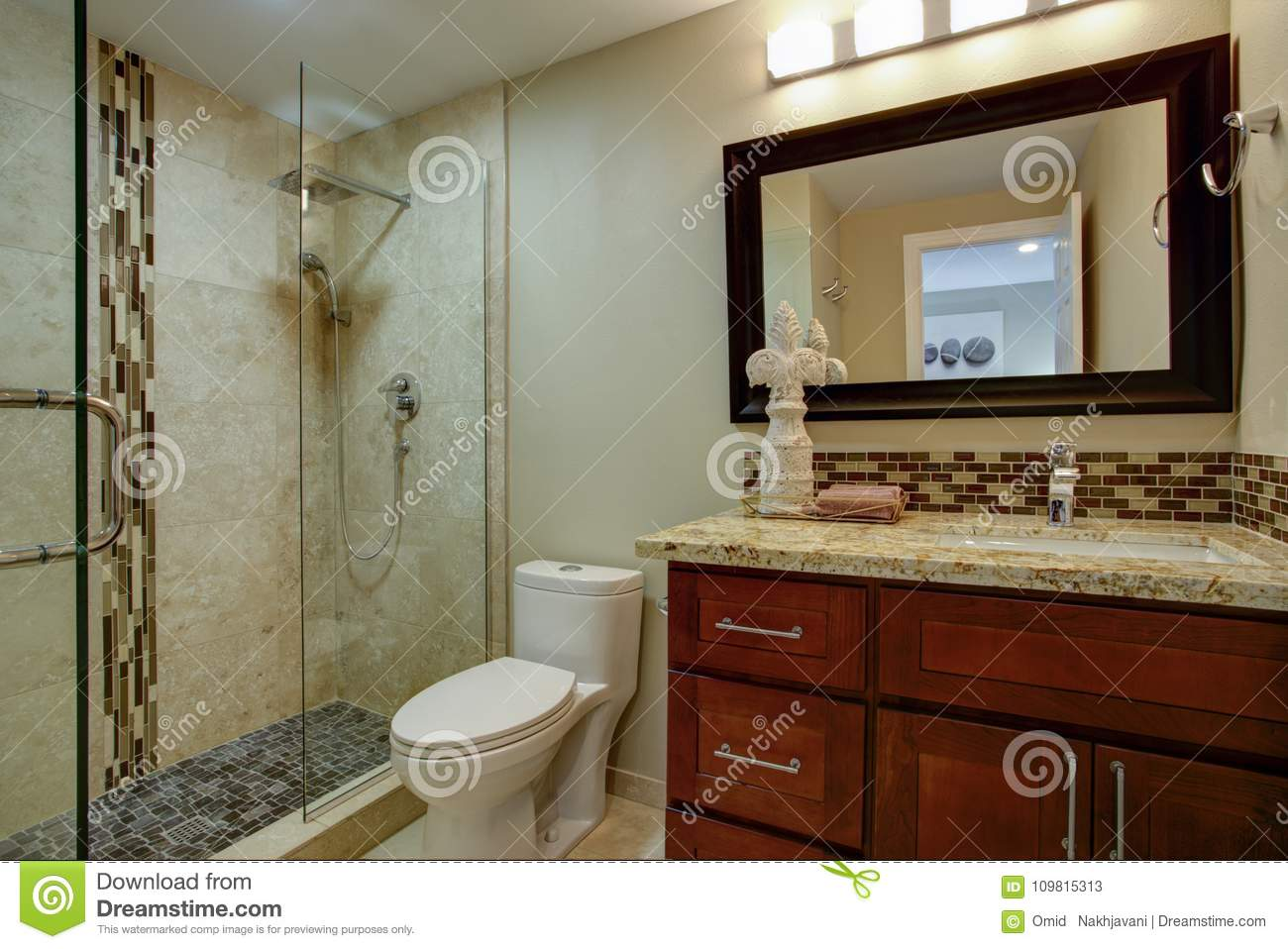 - Elegant Bathroom With A Mahogany Stained Vanity Stock Image
