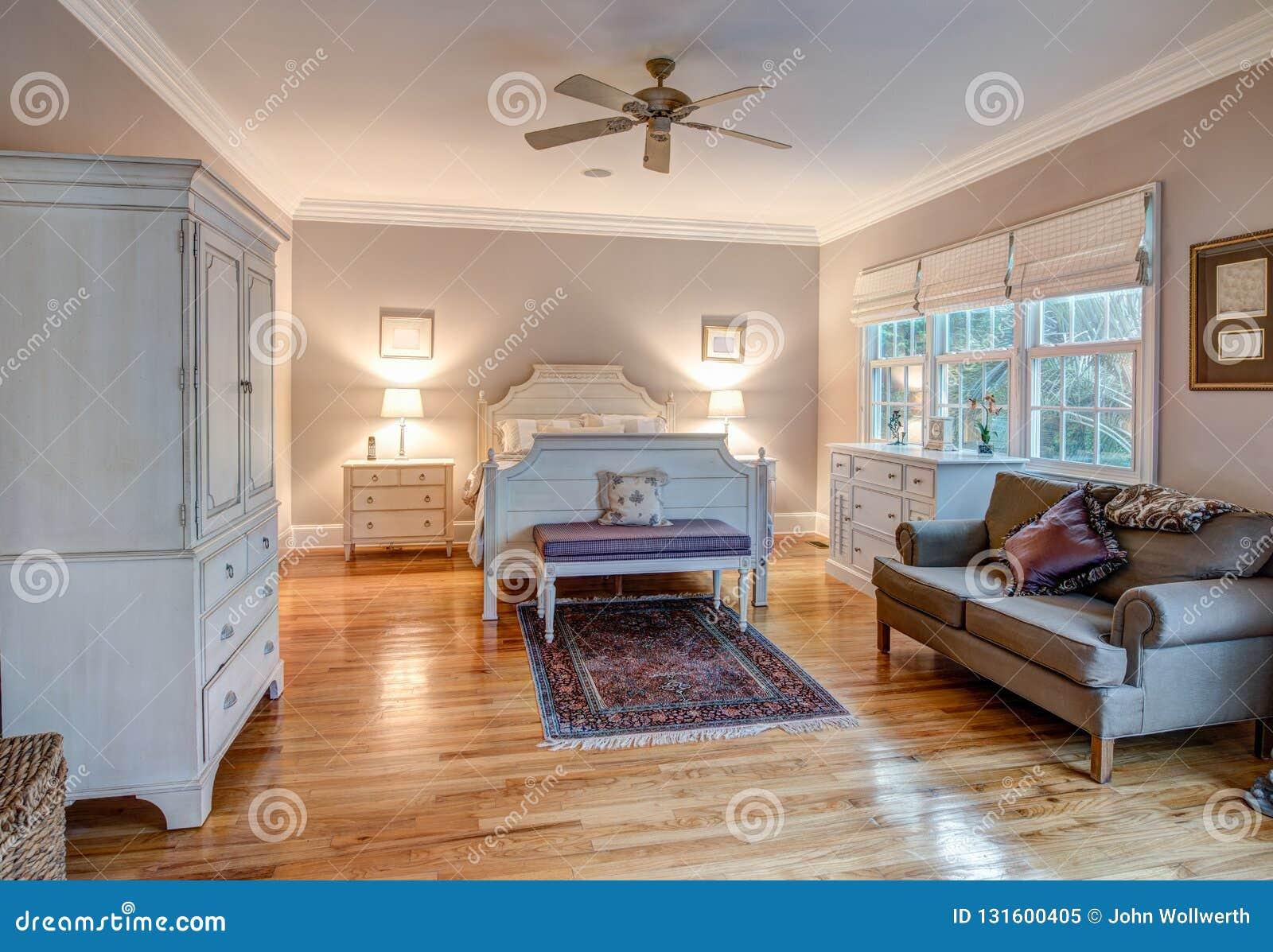 Elegant Bedroom With Wood Floors And Tasteful Furniture Stock Image - Image Of Dresser, Hard: 131600405