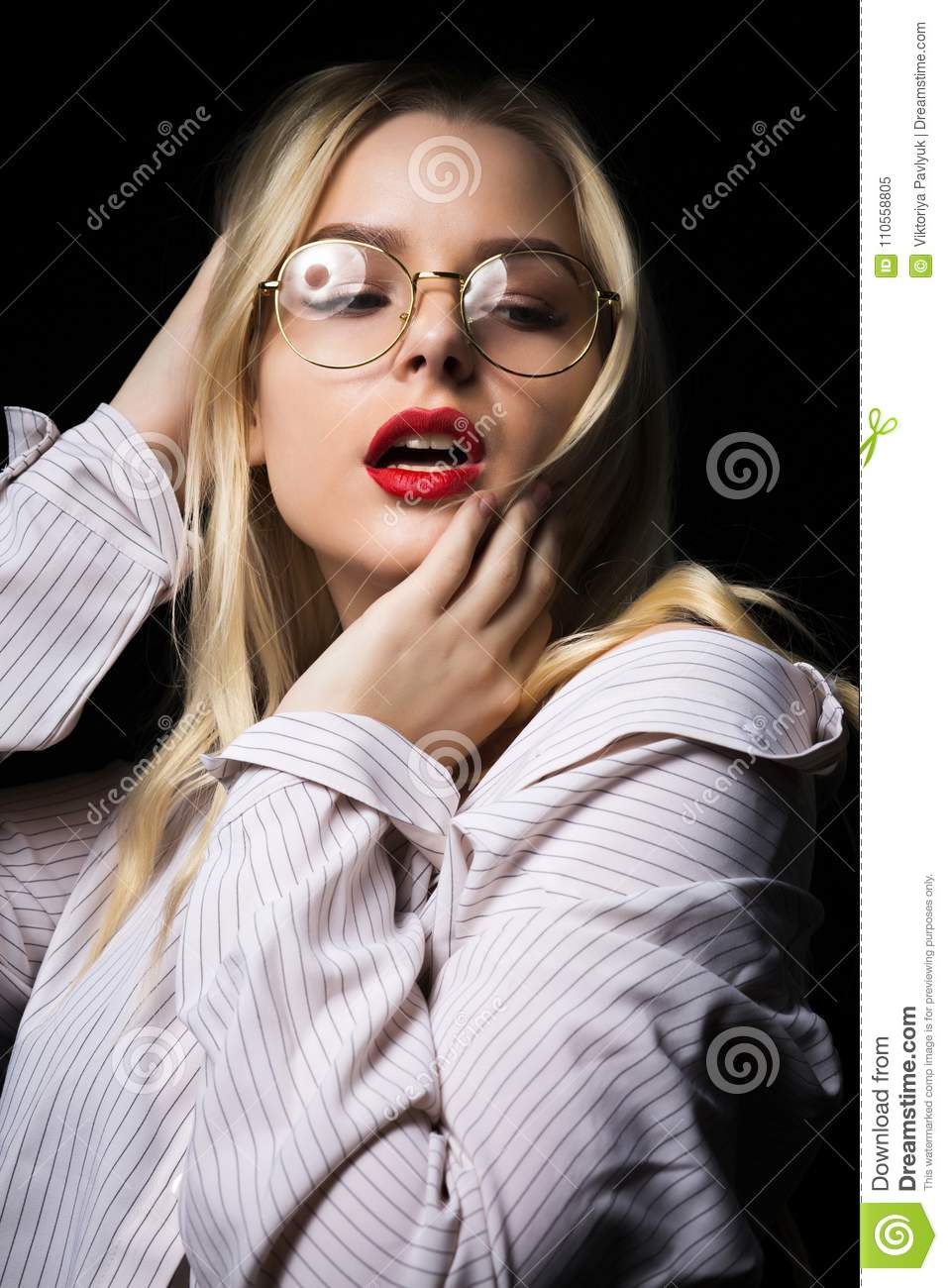 Naked blonde girl wearing glasses