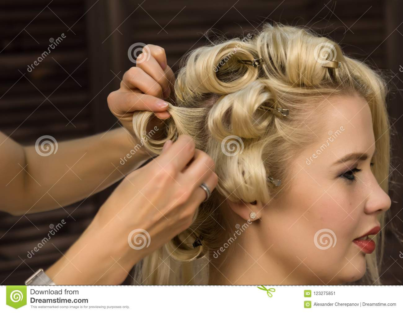 Elegant Blonde Woman In Beauty Saloon Hairdresser Does Coiffure In