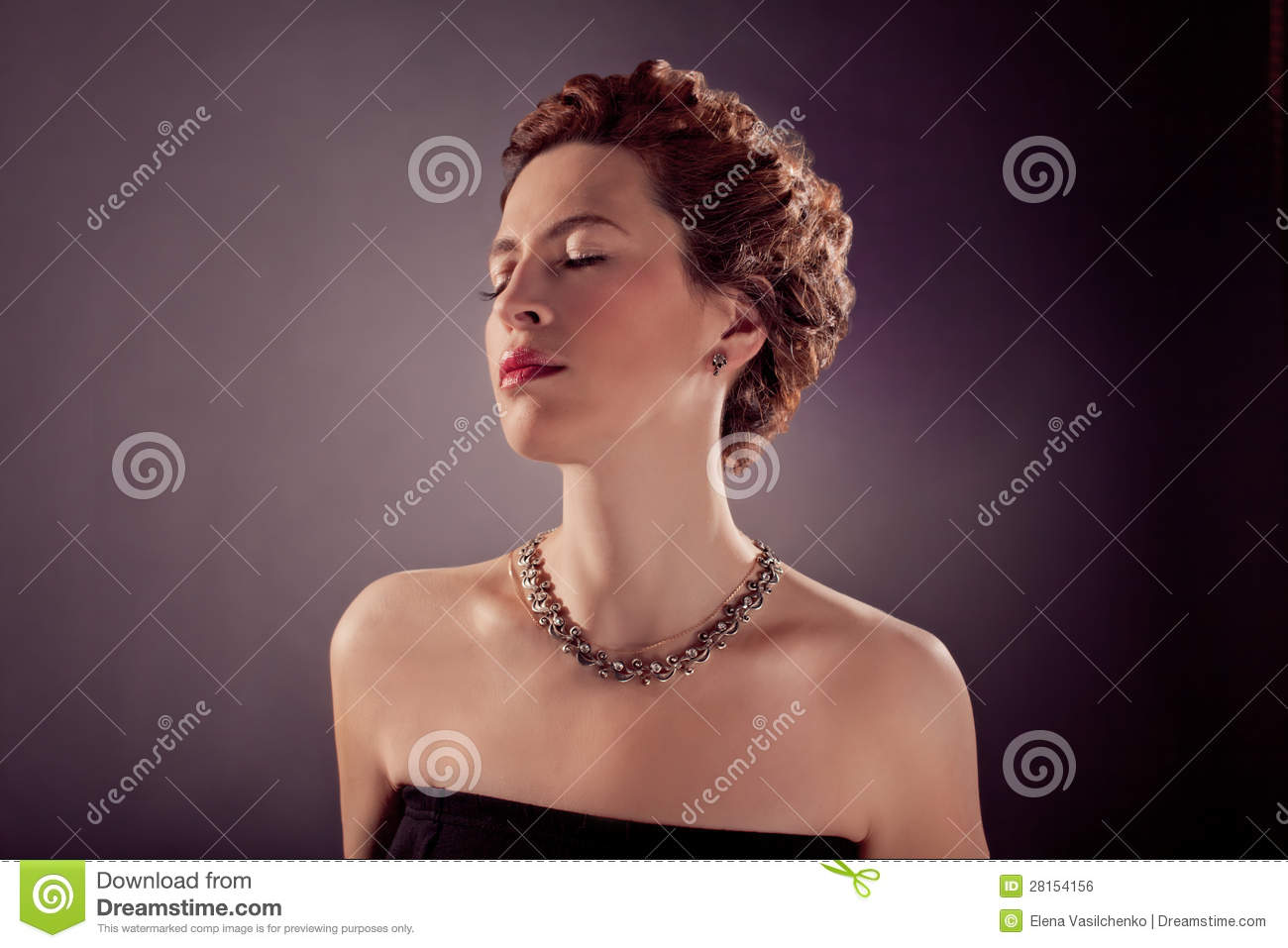 Elegant bosomy mature woman in black tight dress and red curly hair.
