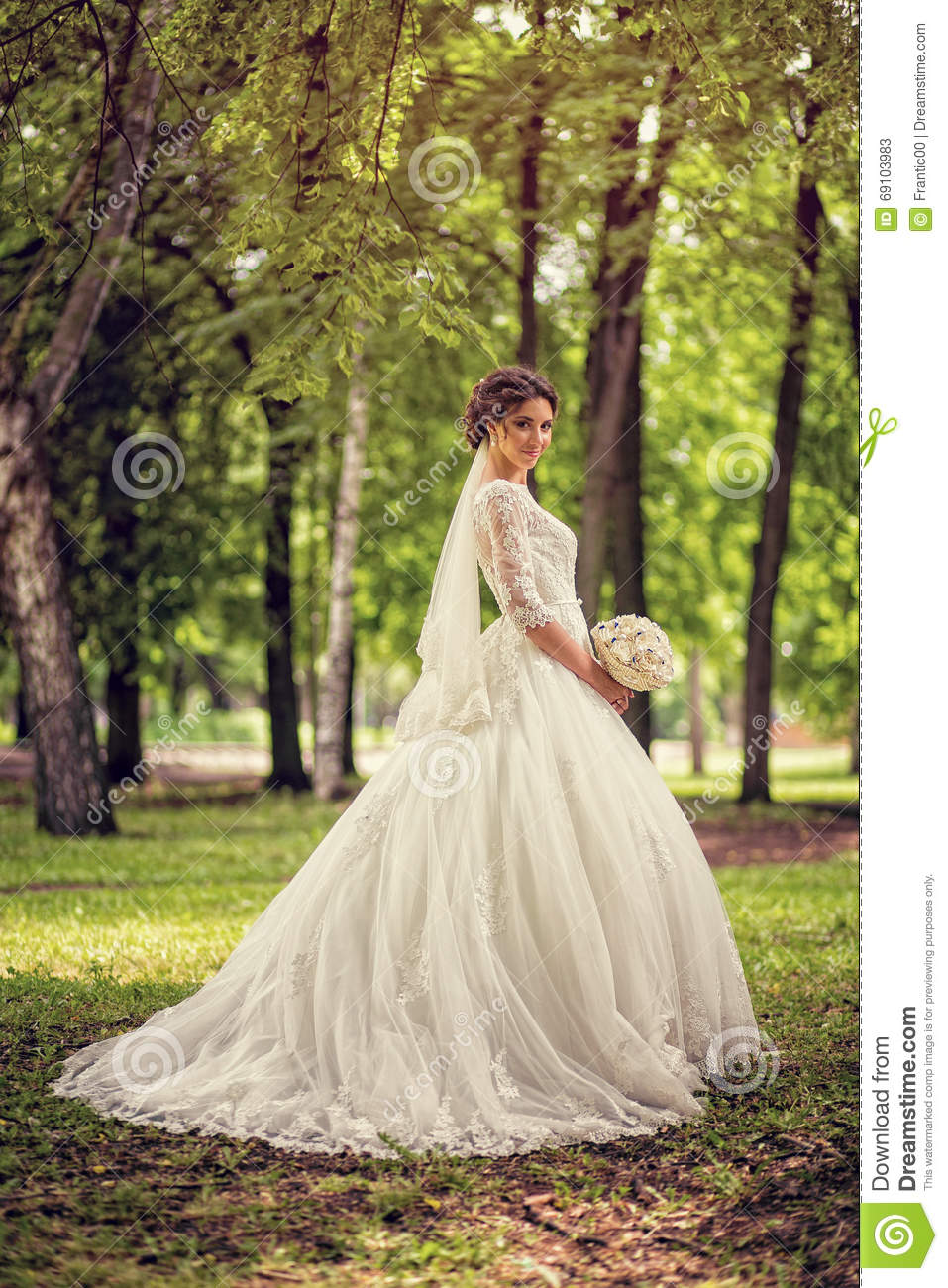 Elegant Bride In Wedding Dress With Dipped Hem Full Length On A Background Of Forest Or Park: Forest Dipped Wedding Dresses At Websimilar.org