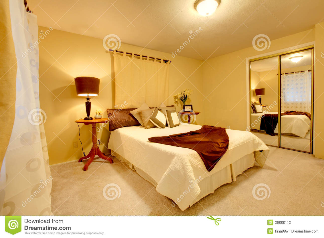 elegant bedroom with light yellow walls and matched bedroom cloth set
