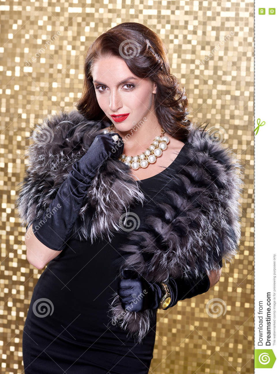 elegant brunette retro woman wearing silver fox fur over gold mosaic background model looking camera 72757508
