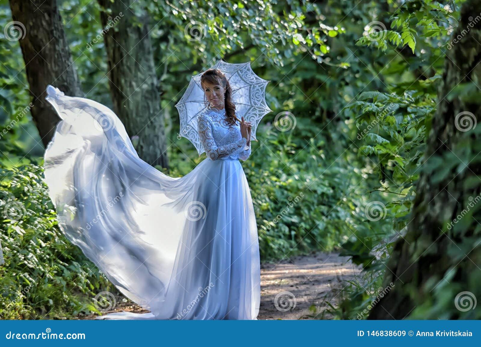 Elegant brunette in a vintage white dress