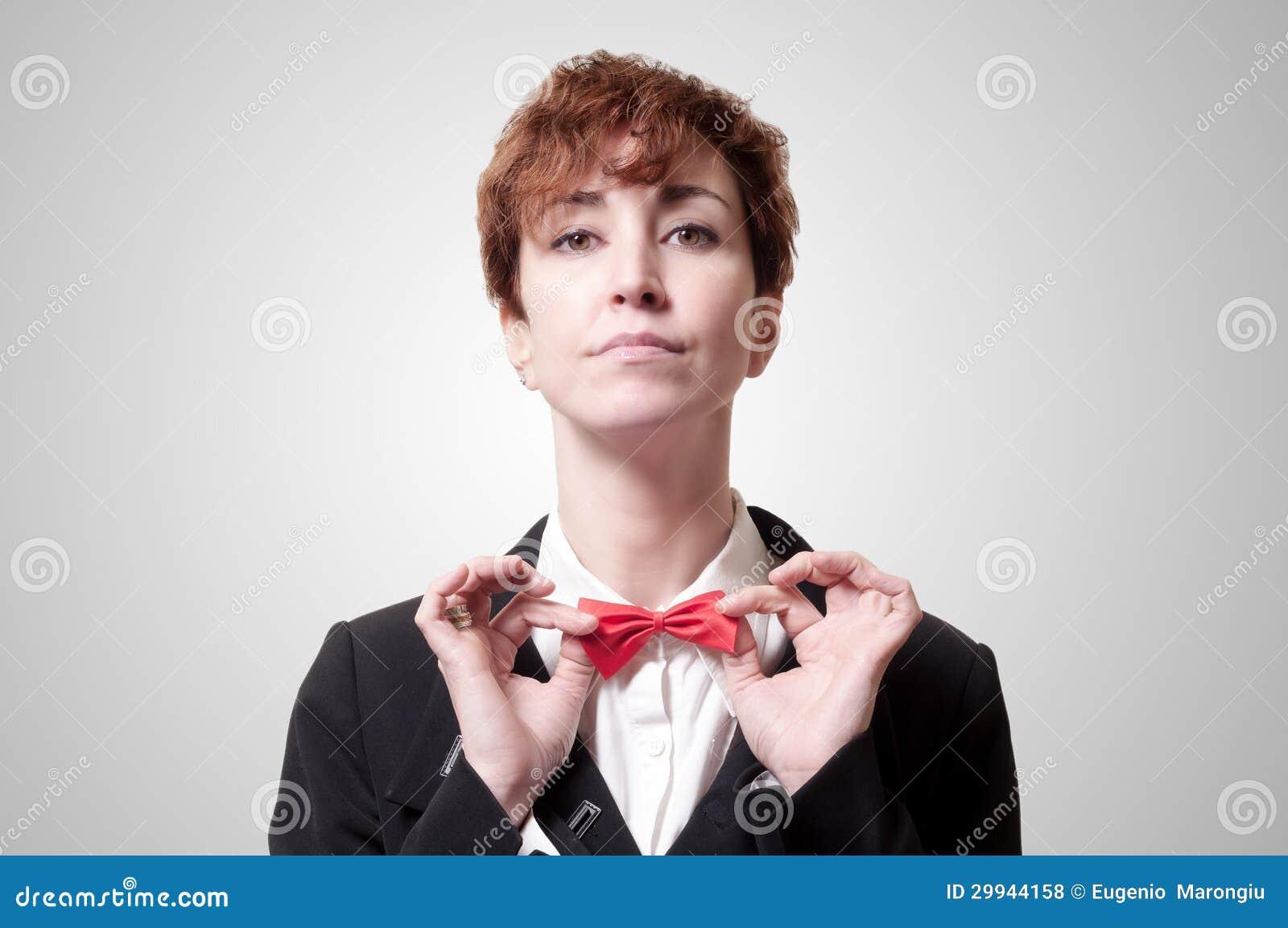 Elegant Businesswoman Standing Against Office Glass Wall