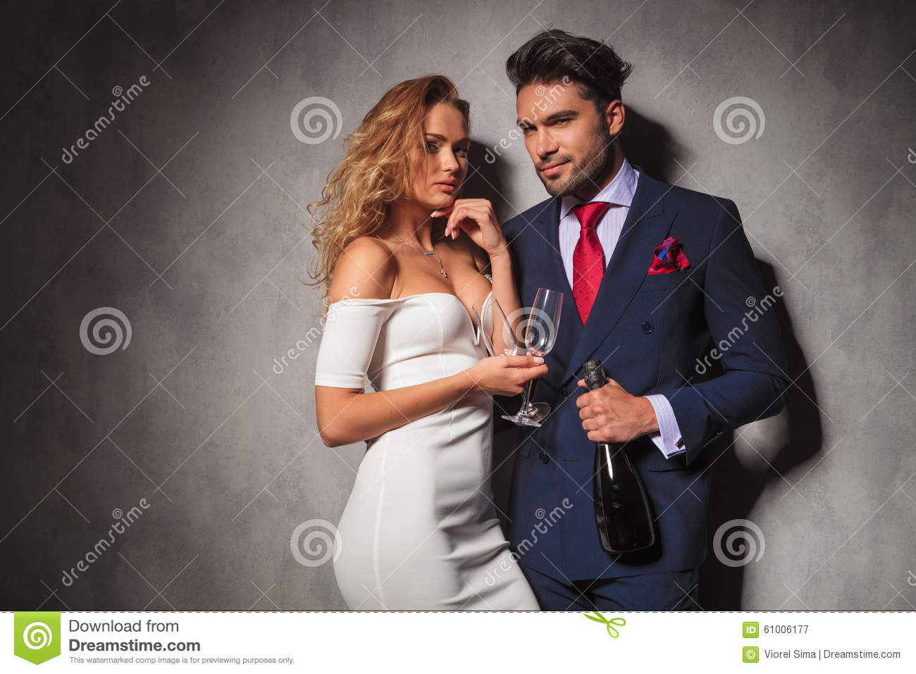 Elegant couple ready to party with champagne
