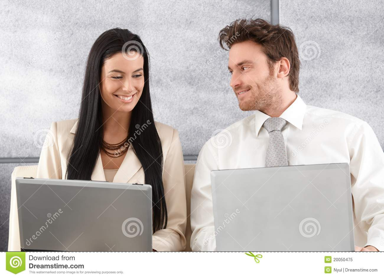 Download Elegant Couple Sitting On Sofa Using Laptop Stock Image - Image of caucasian, goodlooking: 20050475