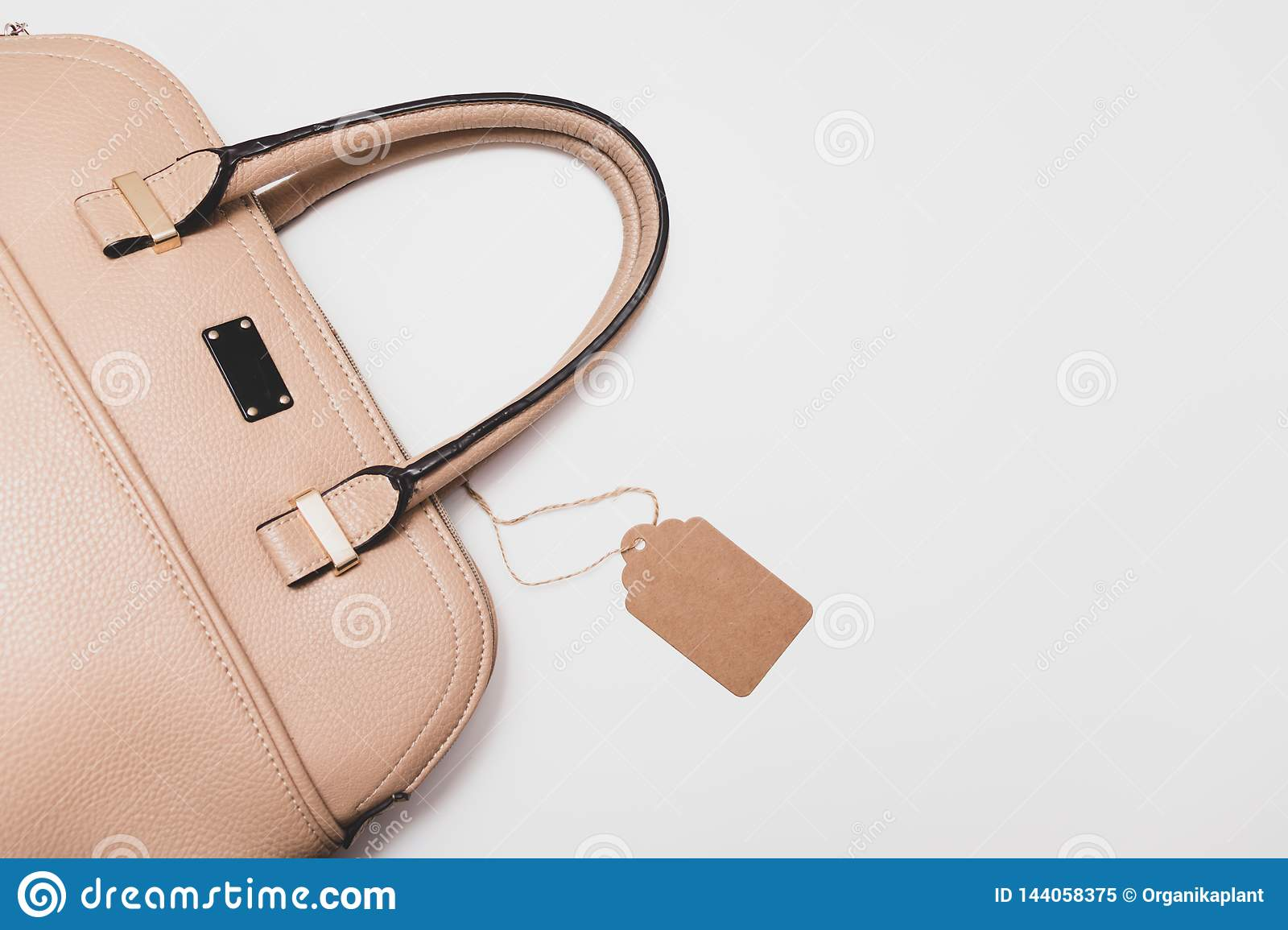 Elegant fashionable formal beige leather handbag for business woman on white background, trendy minimalistic luxury style with