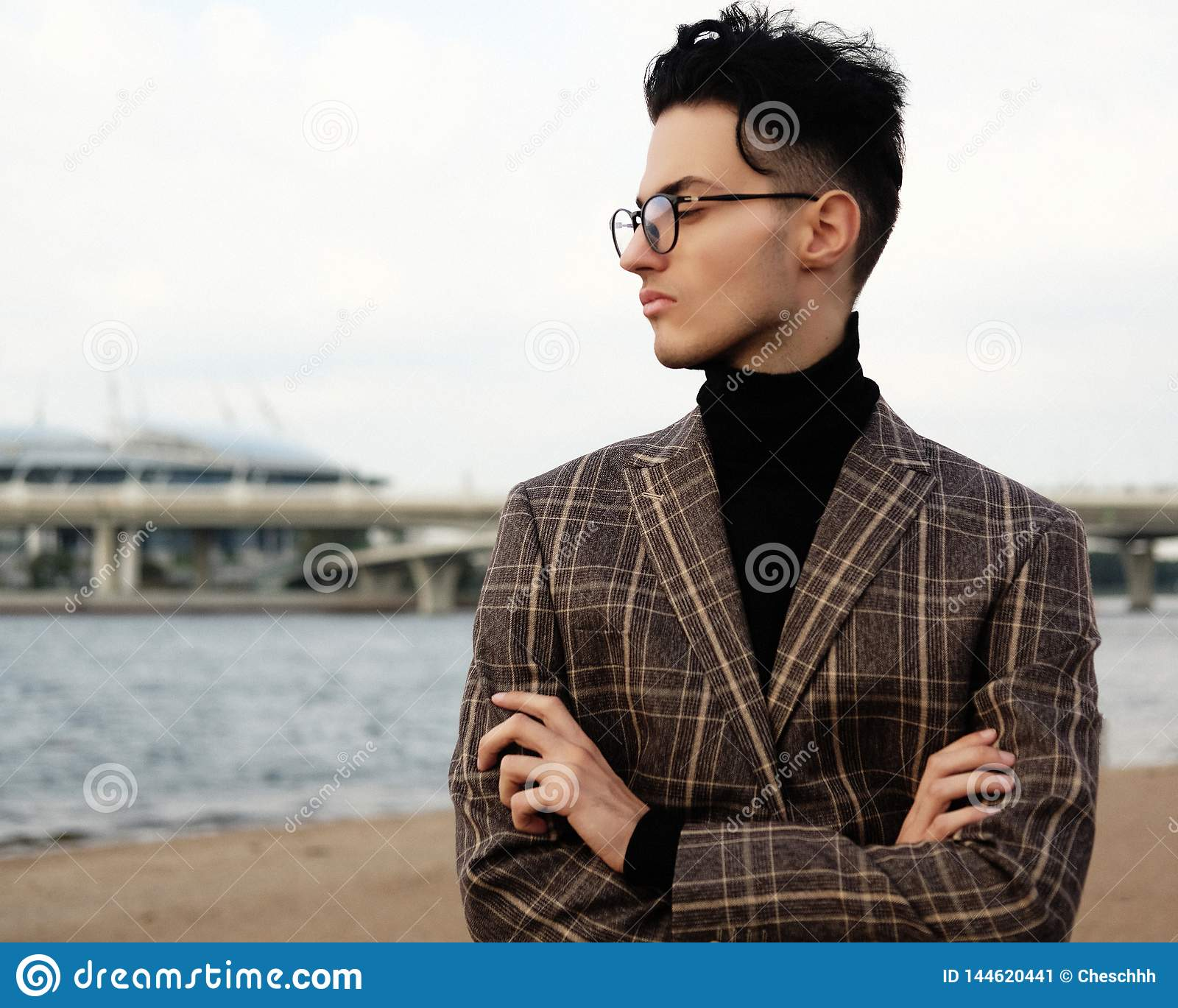 Elegant fashionable man in glasses outdoor, summer day