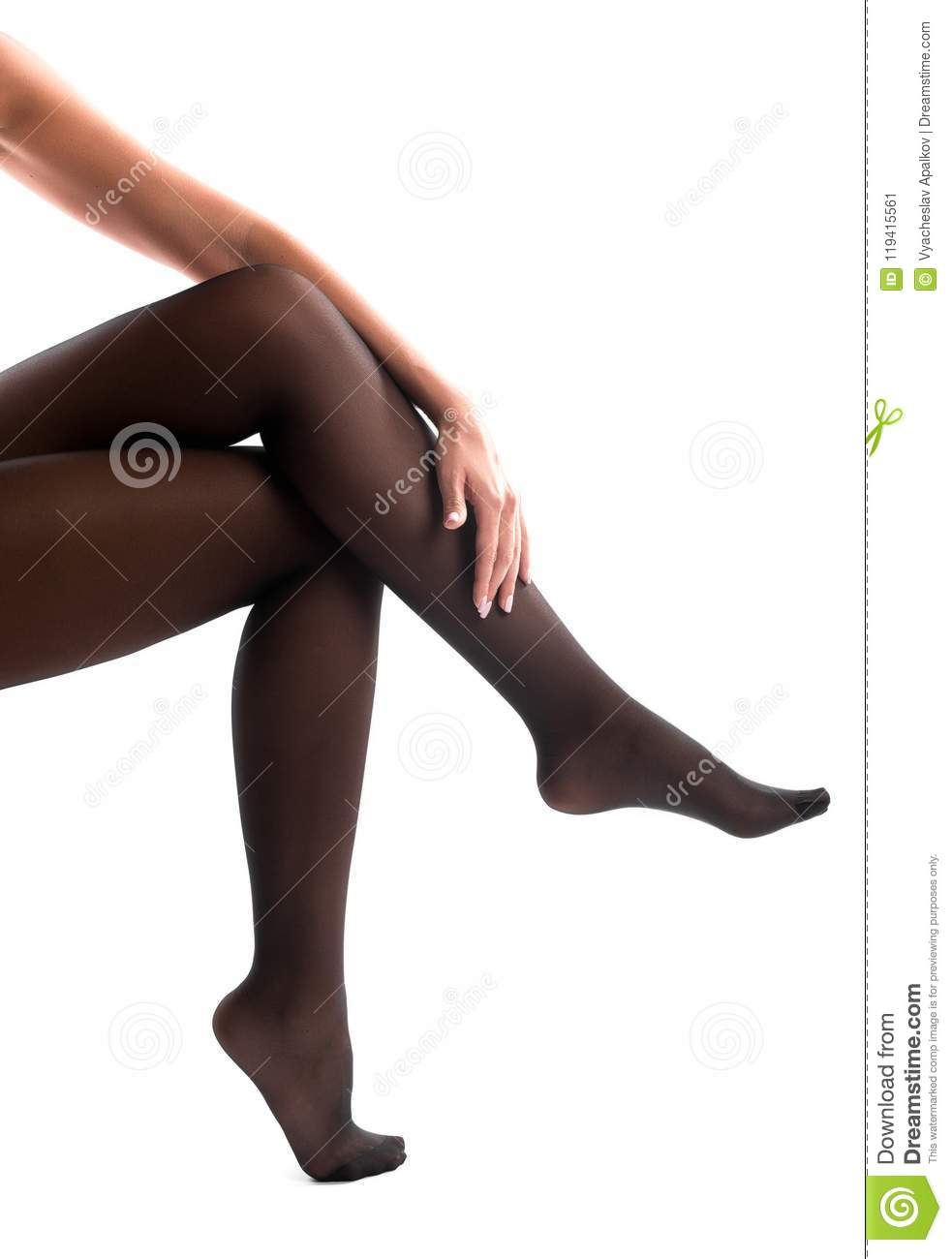 Female arm embracing slender crossed legs isolated