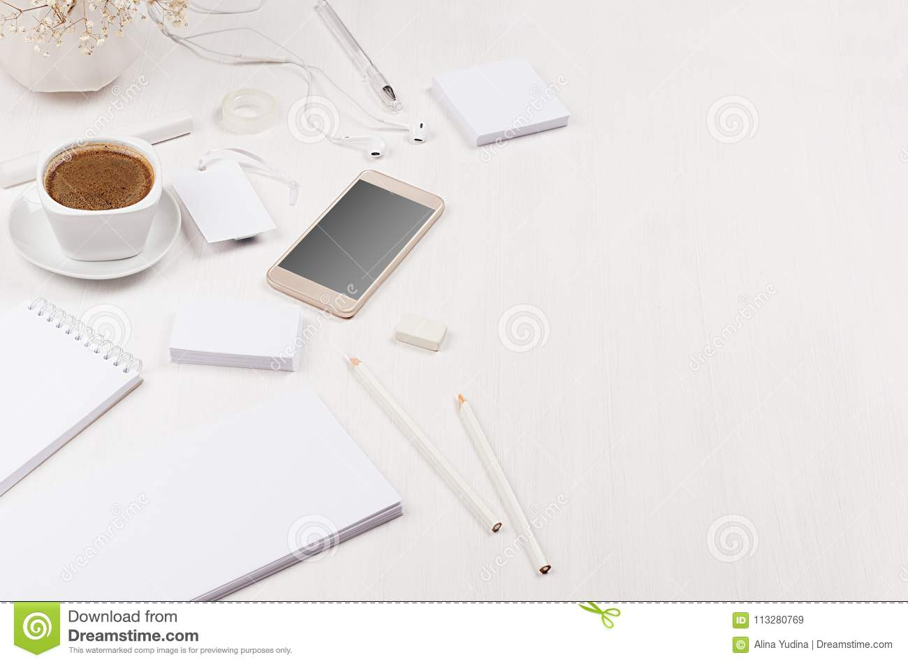elegant gentle soft white working place with white stationery