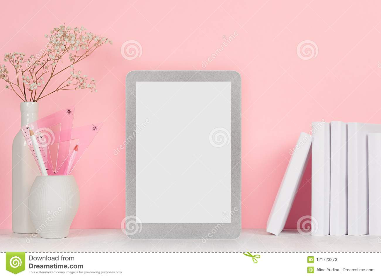 elegant home workplace with stylish silver blank tablet and white