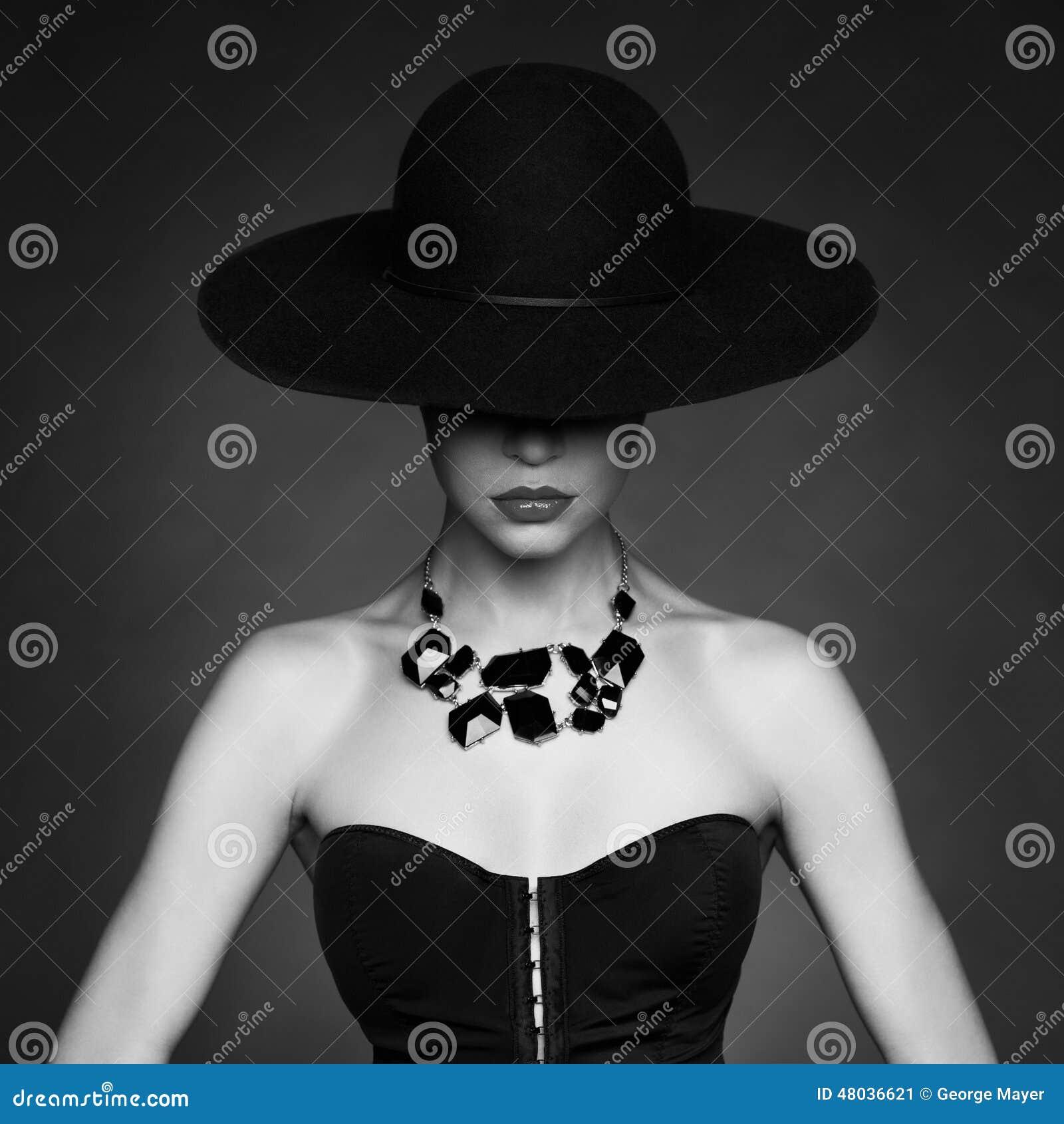 Classy And Glamorous Photo: Elegant Lady In Hat Stock Photo