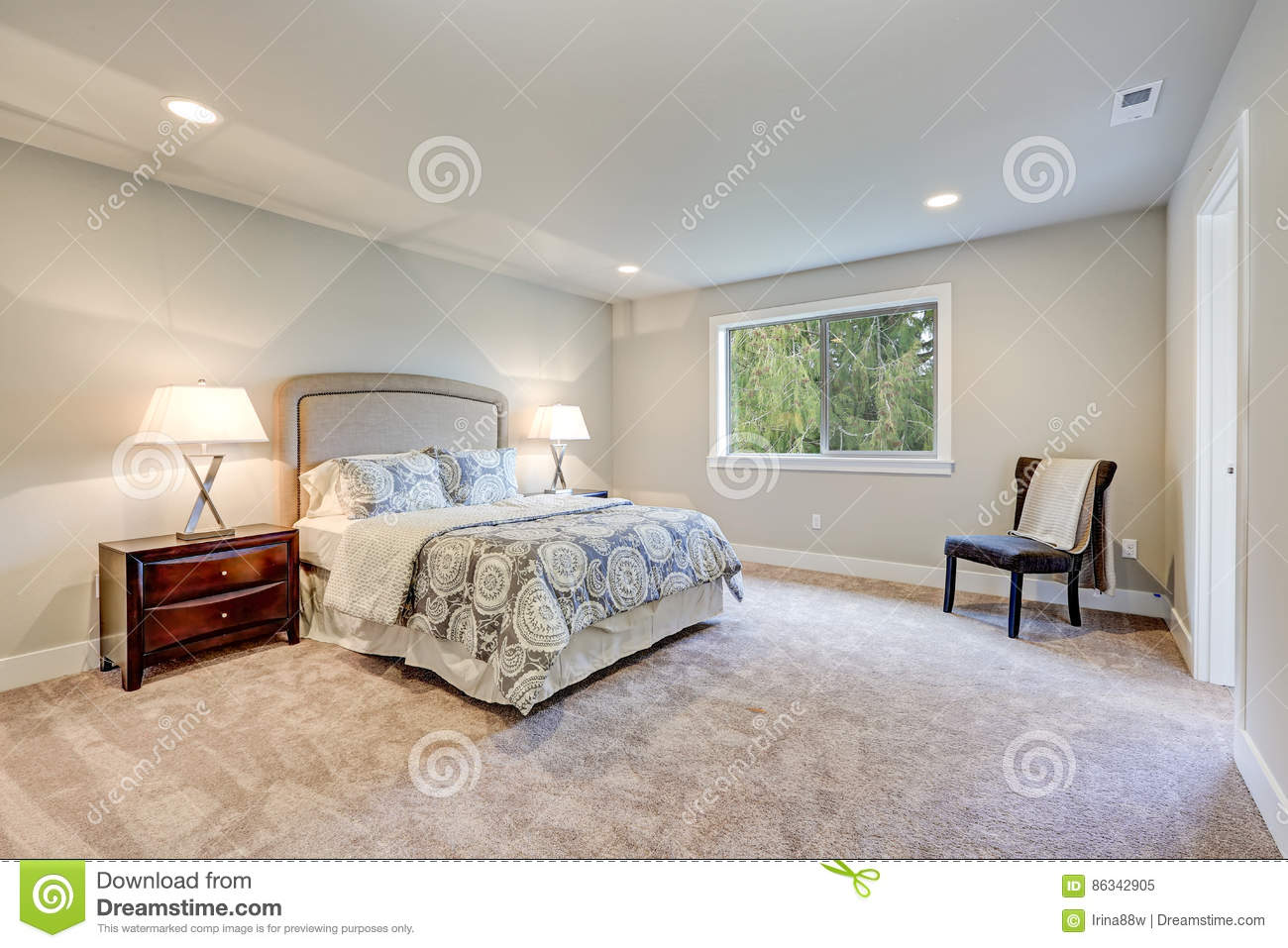 Elegant Light Filled Master Bedroom With Queen Bed Stock Image