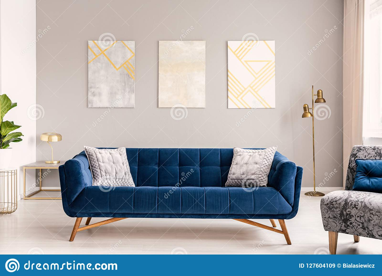 Elegant Living Room Interior With A Comfortable Big Blue ...