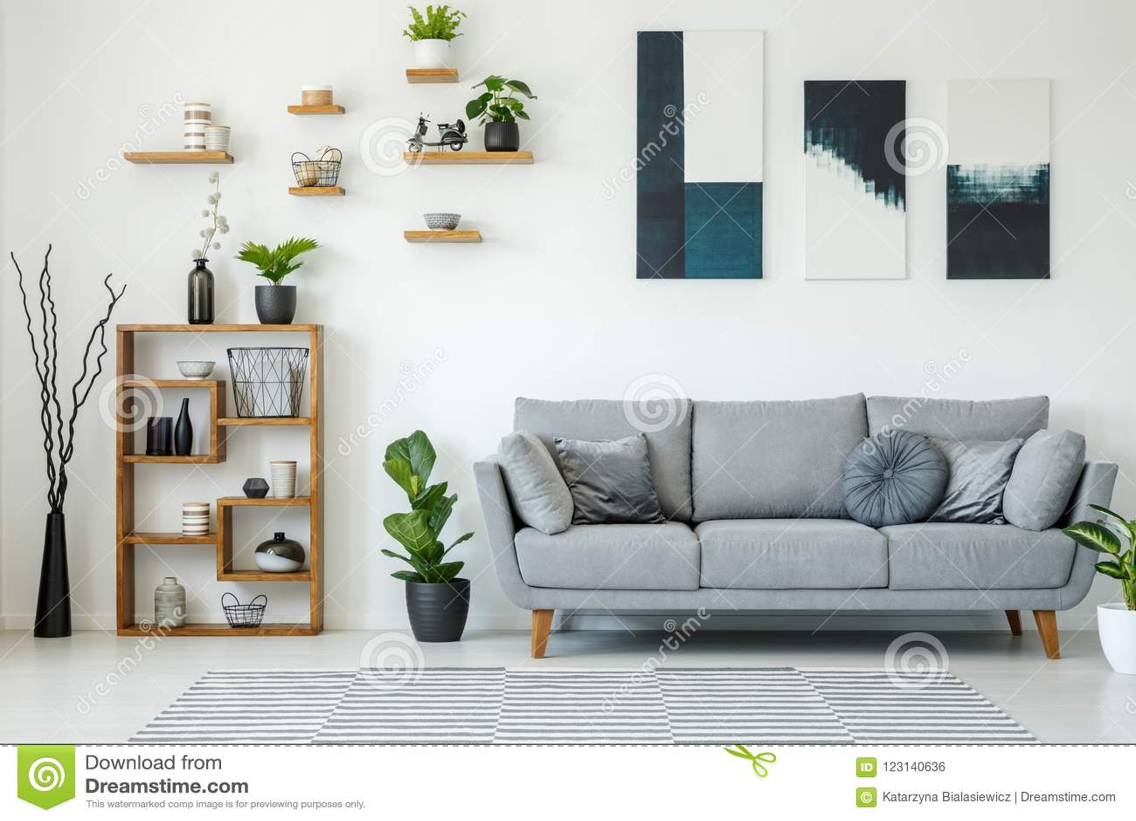 Elegant Living Room Interior With A Grey Sofa Wooden Shelves P