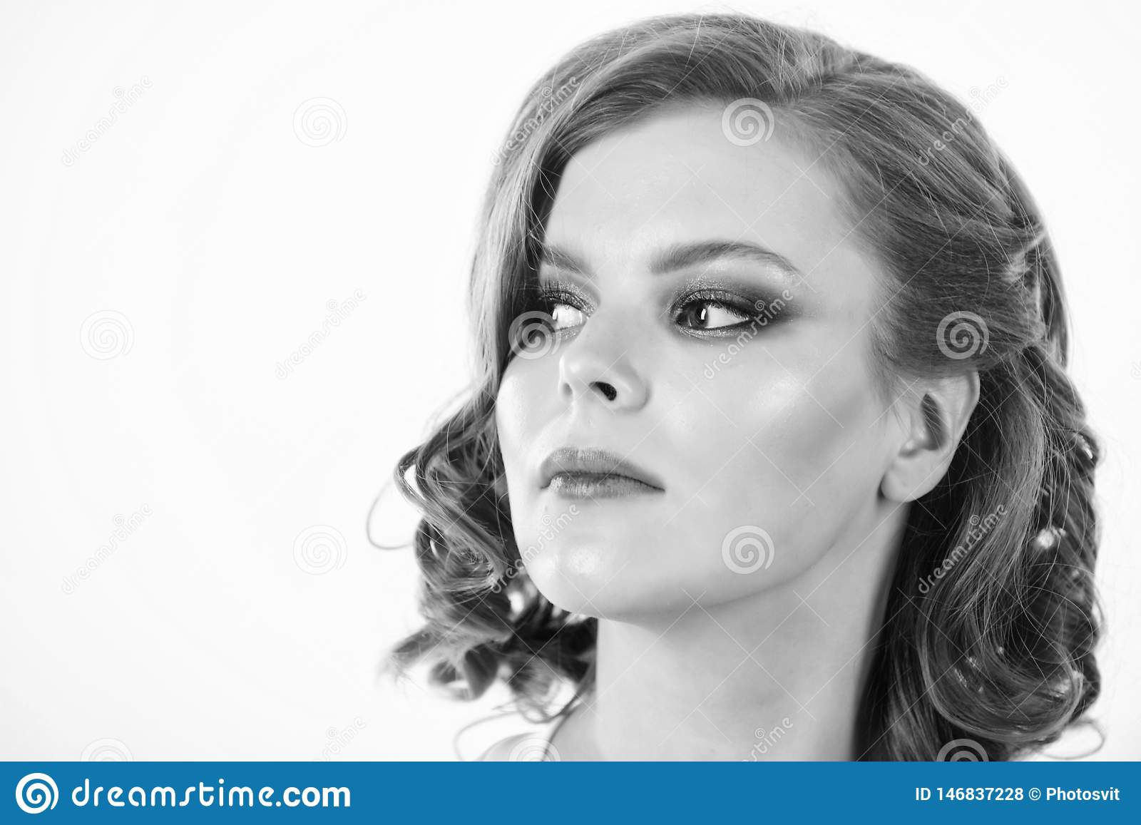 Elegant makeup concept. Retro and vintage. Girl with perfect healthy skin and beautiful makeup. Girl retro hairstyle and