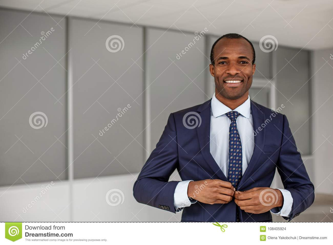Elegant man is expressing gladness at work