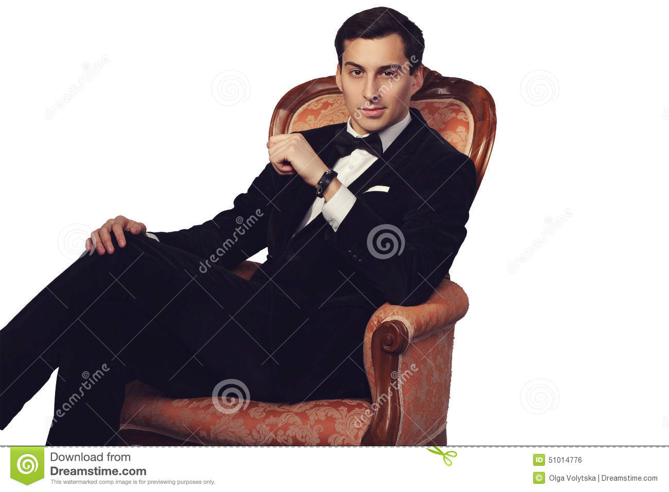 Elegant man in suit sitting on vintage armchair luxury for Sitting in armchair
