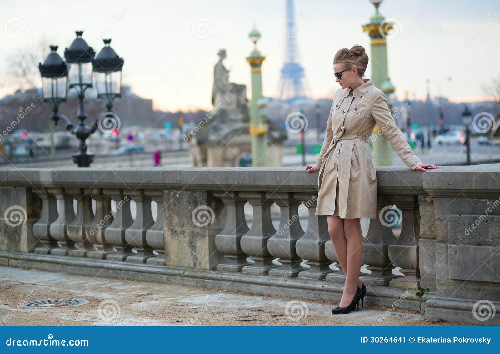 Elegant Parisian woman in Tuileries garden